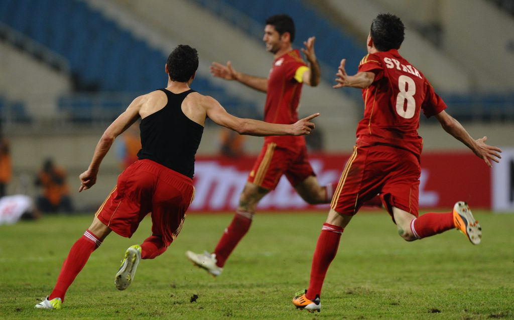 Un gol di Aldouni nel deludente pareggio (1-1) contro l'Oman, nel 2012 (Hoang Dinh Nam/Afp/Getty Images)