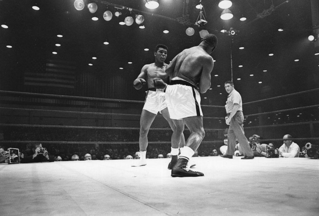 FEBRUARY 25, 1964 - MIAMI: American boxer Cassius Clay (now Muhammad Ali), on his way to defeating Sonny Liston during their world heavyweight title fight at Miami Beach, Florida. (Photo by Harry Benson/Getty Images)
