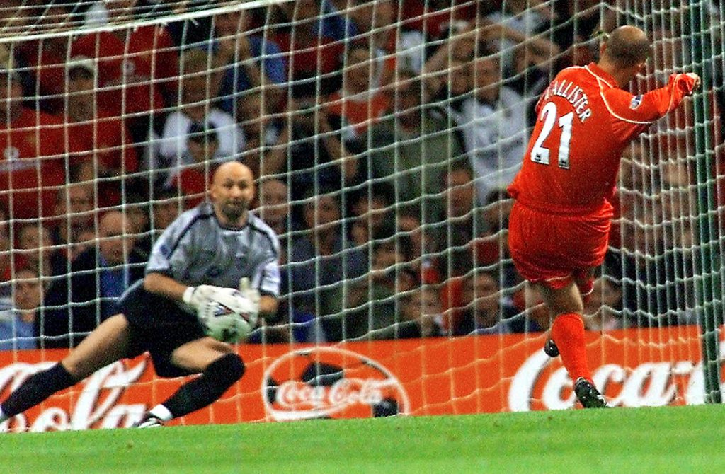 CARDIFF, UNITED KINGDOM: Liverpool's Gary McAllister sends Manchester United's French goalkeeper Fabien Barthez the wrong way to score the first goal 12 August 2001, during their FA Charity Shield match at the Millennium Stadium in Cardiff. The Charity Shield is contested by the Premiership Champions (Manchester United) and the FA Cup winners (Liverpool). The Premiership starts next week on 18 August 2001. AFP PHOTO/Gerry PENNY (Photo credit should read GERRY PENNY/AFP/Getty Images)