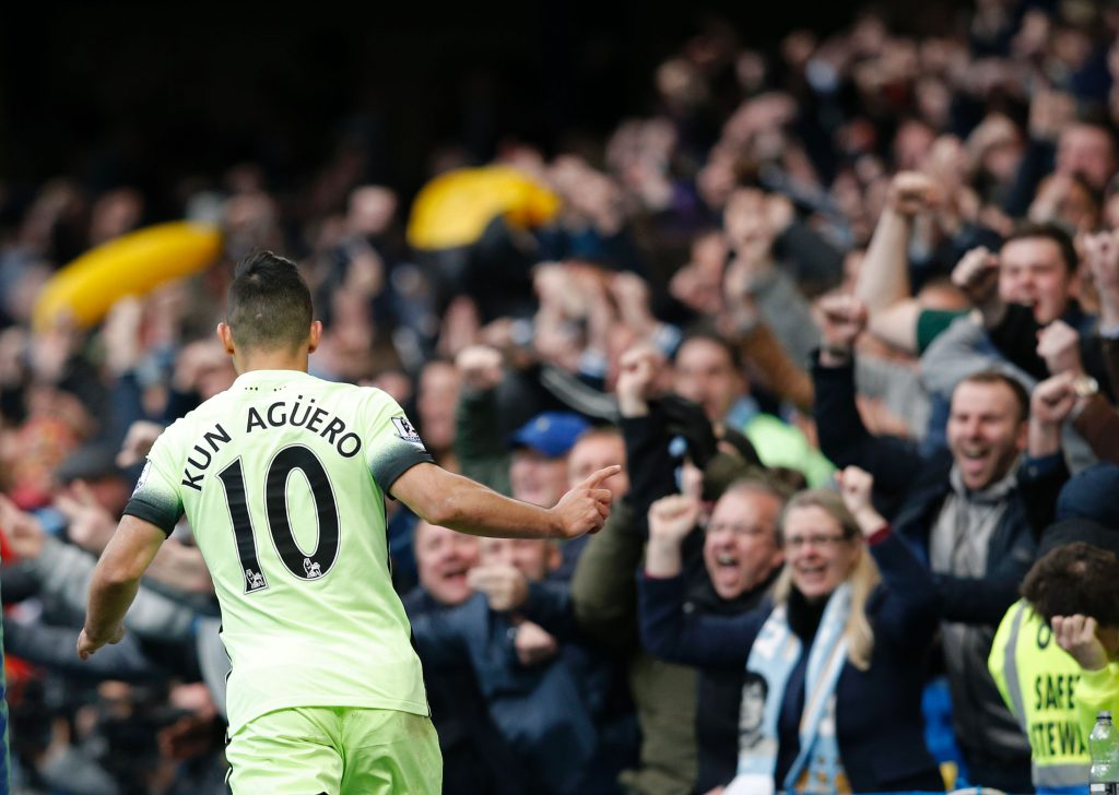 Manchester City's Argentinian striker Sergio Aguero celebrates after scoring their second goal during the English Premier League football match between Chelsea and Manchester City at Stamford Bridge in London on April 16, 2016. / AFP / Adrian DENNIS / RESTRICTED TO EDITORIAL USE. No use with unauthorized audio, video, data, fixture lists, club/league logos or 'live' services. Online in-match use limited to 75 images, no video emulation. No use in betting, games or single club/league/player publications. / (Photo credit should read ADRIAN DENNIS/AFP/Getty Images)
