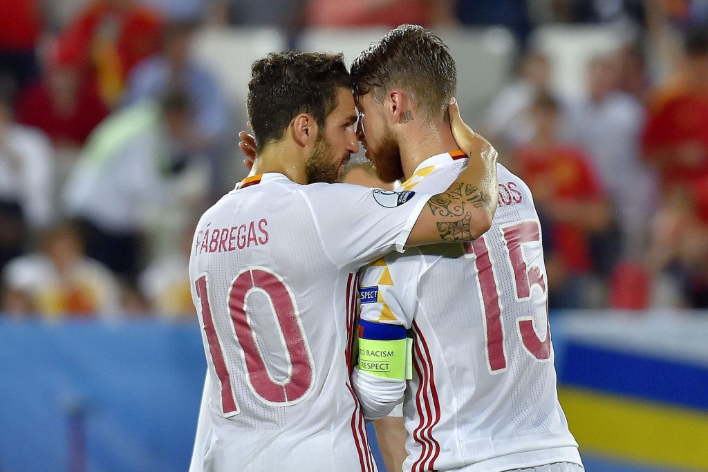Spain's midfielder Cesc Fabregas (L) speaks with Spain's defender Sergio Ramos before his penalty during the Euro 2016 group D football match between Croatia and Spain at the Matmut Atlantique stadium in Bordeaux on June 21, 2016. / AFP / LOIC VENANCE (Photo credit should read LOIC VENANCE/AFP/Getty Images)