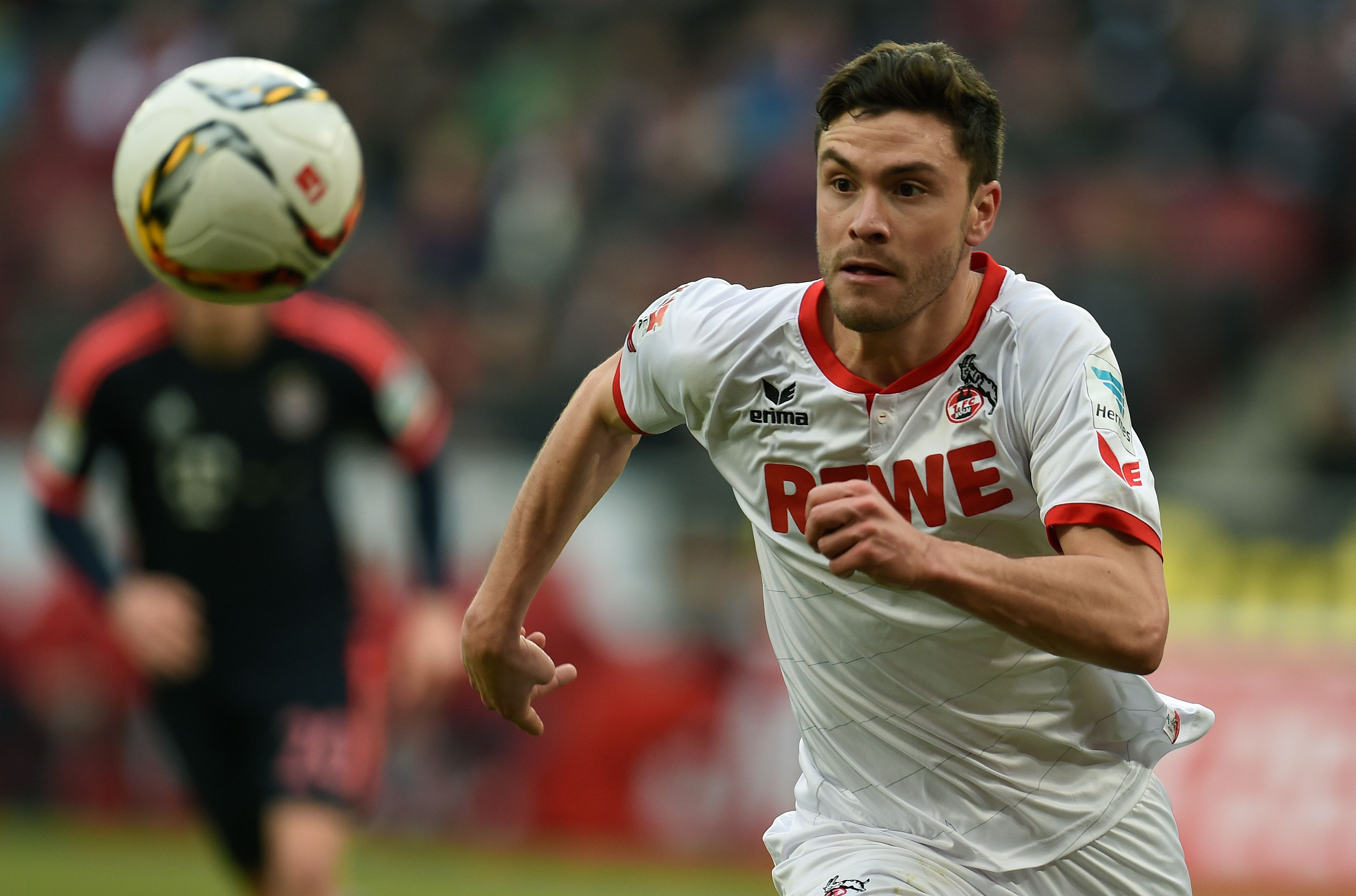 Cologne's defender Jonas Hector runs with the ball during the German Bundesliga first division football match between FC Cologne vs FC Bayern Munich in Cologne, western Germany, on March 19, 2016. / AFP / PATRIK STOLLARZ / RESTRICTIONS: DURING MATCH TIME: DFL RULES TO LIMIT THE ONLINE USAGE TO 15 PICTURES PER MATCH AND FORBID IMAGE SEQUENCES TO SIMULATE VIDEO. == RESTRICTED TO EDITORIAL USE == FOR FURTHER QUERIES PLEASE CONTACT DFL DIRECTLY AT + 49 69 650050 (Photo credit should read PATRIK STOLLARZ/AFP/Getty Images)