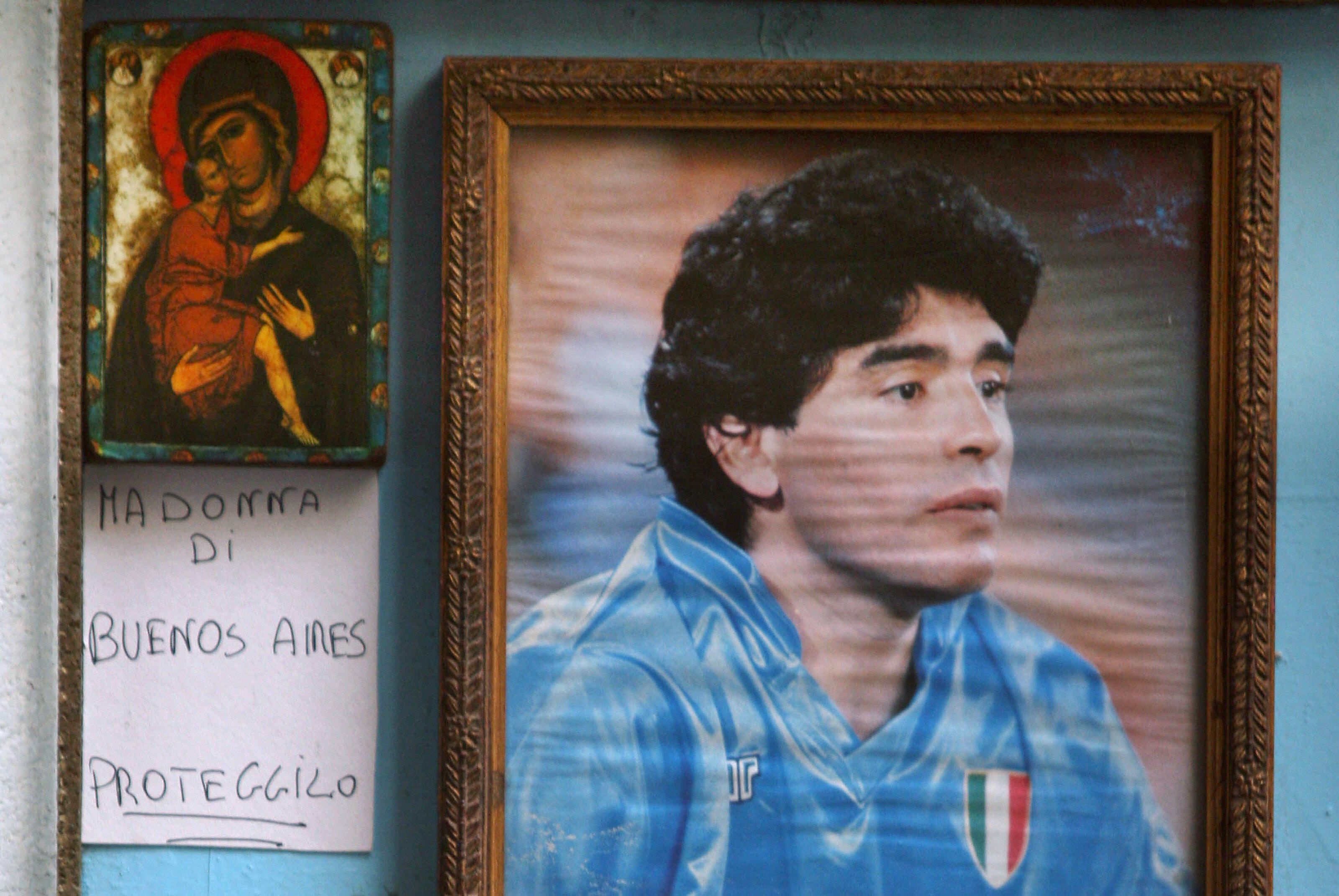 Naples, ITALY: Picture of an altar in tribute for famous Argentine star Diego Maradona, in a street of Naples, 16 April 2007. The football idol Diego Maradona was rushed to emergency, 13 April 2007, just two days after being discharged from a different facility after 13 days of treatment for excessive drinking which sparked a return of the chronic hepatitis he has suffered for years. AFP PHOTO/Mario LAPORTA (Photo credit should read MARIO LAPORTA/AFP/Getty Images)