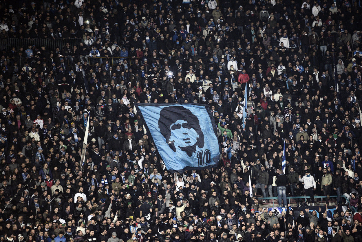 SSC Napoli's fans show a flag rapresenting Argentinian former SSC Napoli player Diego Armando Maradona during the Serie A football match SSC Napoli vs A.S. Roma at San Paolo Stadium in Naples on January 6, 2013. AFP PHOTO / ROBERTO SALOMONE (Photo credit should read ROBERTO SALOMONE/AFP/Getty Images)
