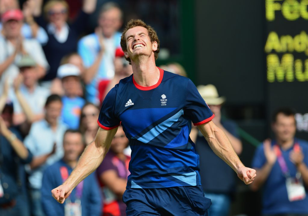 Great Britain's Andy Murray celebrates after winning the men's singles gold medal match of the London 2012 Olympic Games by defeating Switzerland's Roger Federer, at the All England Tennis Club in Wimbledon, southwest London, on August 5, 2012.   AFP PHOTO / MARTIN BERNETTI        (Photo credit should read MARTIN BERNETTI/AFP/GettyImages)