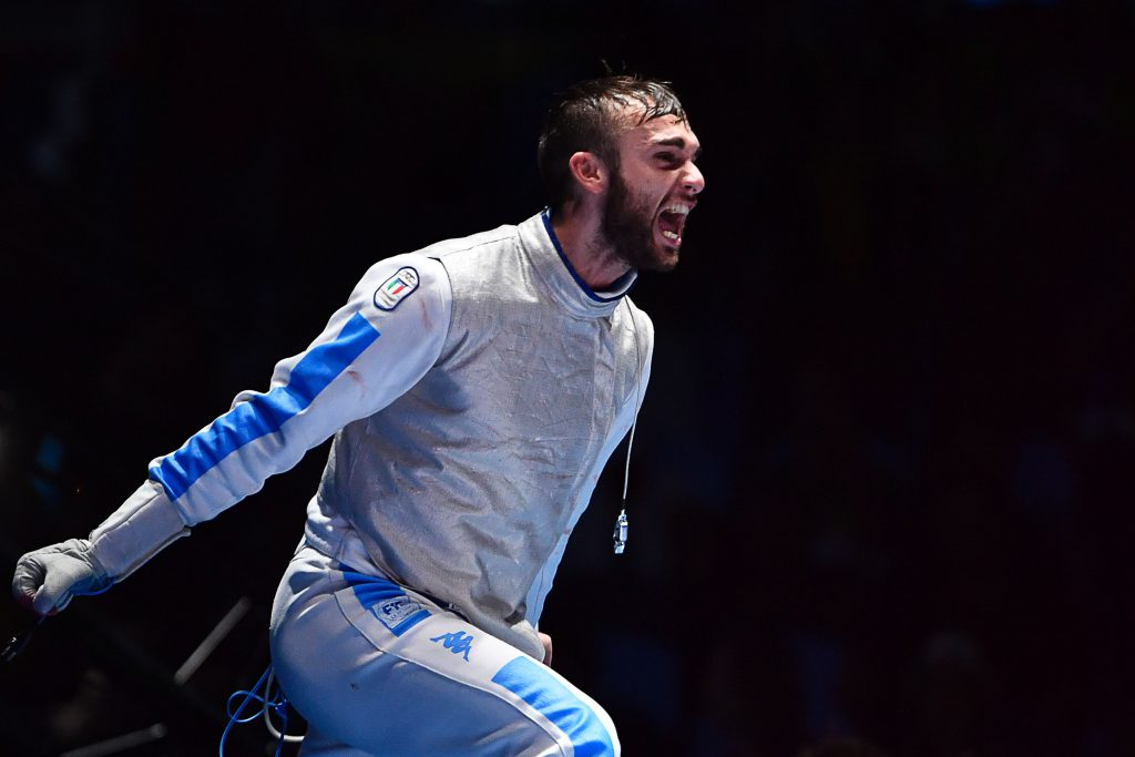 Italy's Daniele Garozzo (R) celebrates celebrates winning against as US Alexander Massialas in the mens individual foil gold medal bout as part of the fencing event of the Rio 2016 Olympic Games, on August 7, 2016, at the Carioca Arena 3, in Rio de Janeiro. / AFP / Fabrice COFFRINI (Photo credit should read FABRICE COFFRINI/AFP/Getty Images)
