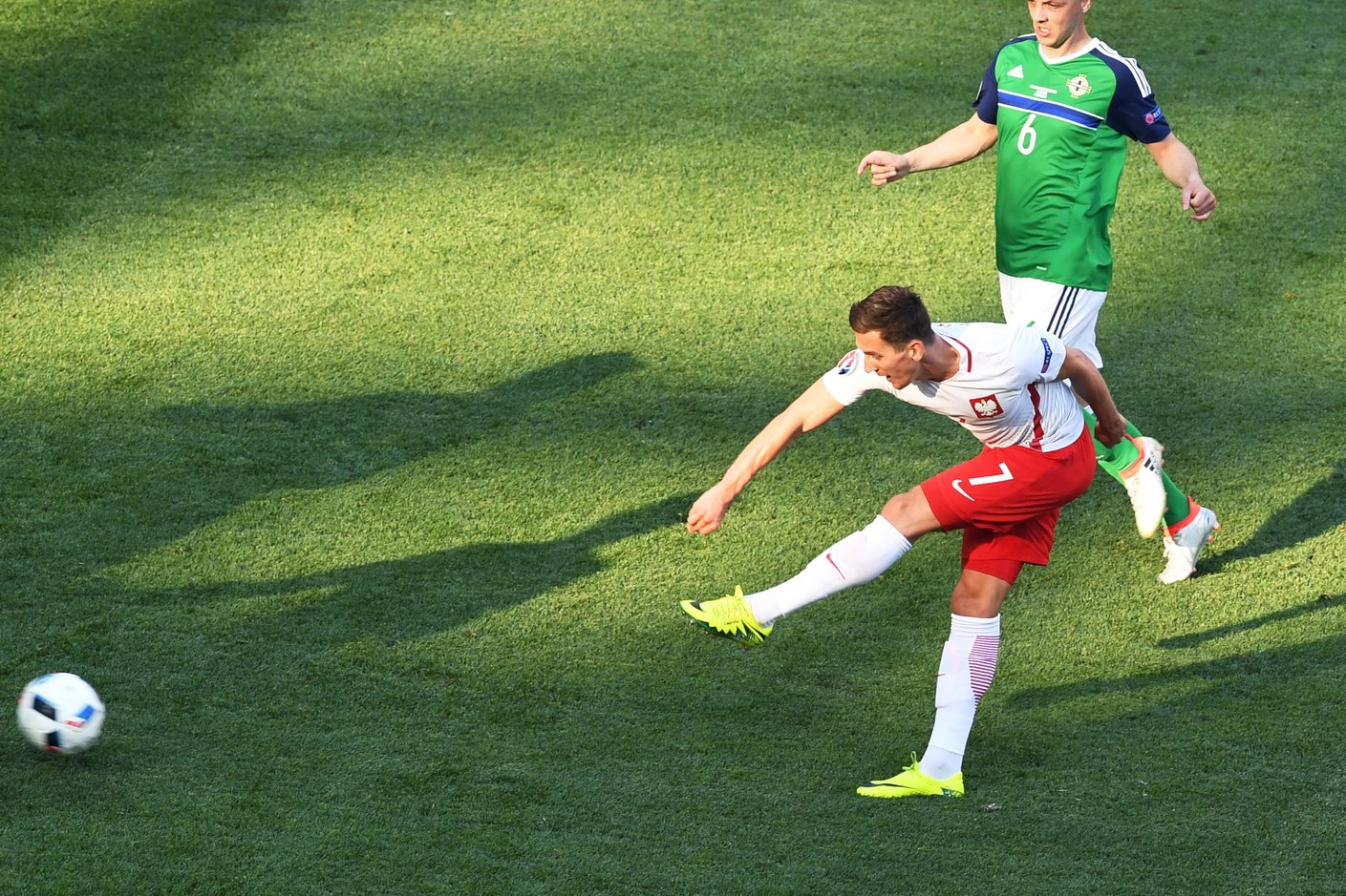 Poland's forward Arkadiusz Milik scores a goal during the Euro 2016 group C football match between Poland and Northern Ireland at the Stade de Nice in Nice on June 12, 2016. / AFP / BORIS HORVAT (Photo credit should read BORIS HORVAT/AFP/Getty Images)