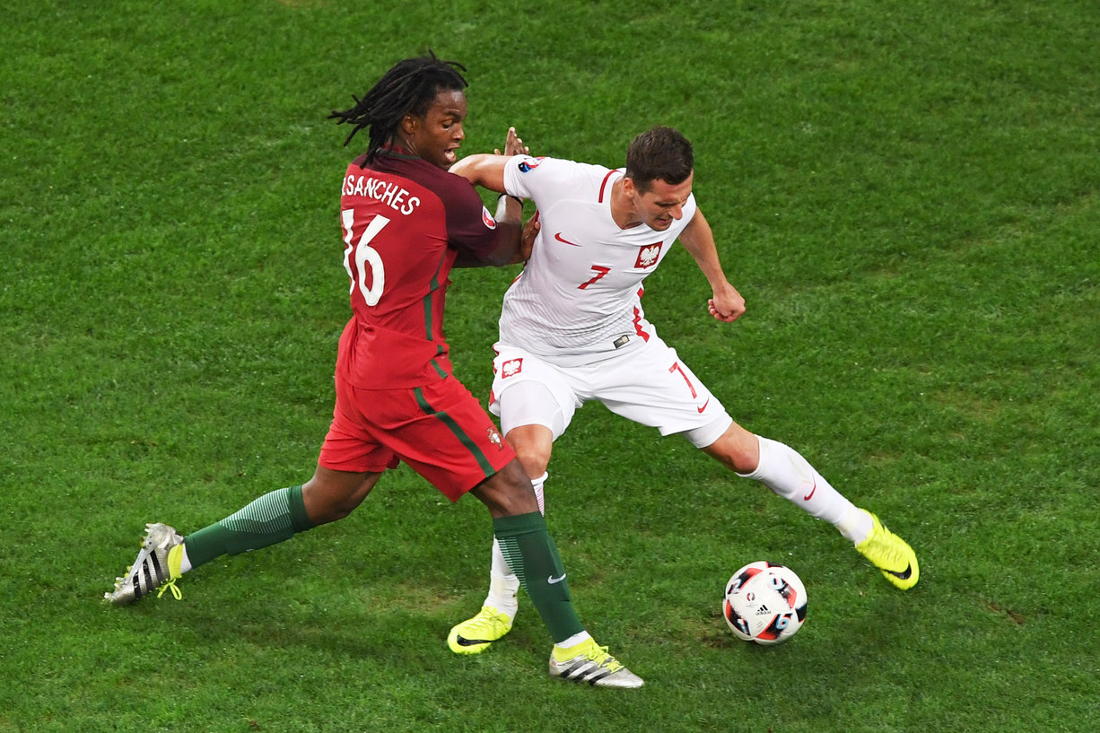Portugal's midfielder Renato Sanches (L) vies with Poland's forward Arkadiusz Milik during the Euro 2016 quarter-final football match between Poland and Portugal at the Stade Velodrome in Marseille on June 30, 2016. / AFP / BORIS HORVAT (Photo credit should read BORIS HORVAT/AFP/Getty Images)