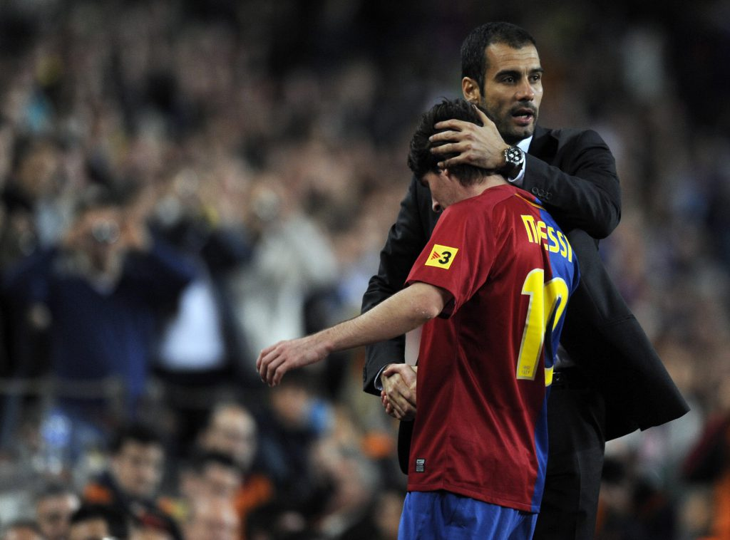 Barcelona's coach Pep Guardiola (L) congratulates his Argentinian attacker Leo Messi after he is substituted during their Spanish League football match against Atletico Madrid at the Camp Nou stadium in Barcelona on October 4, 2008. AFP PHOTO / LLUIS GENE (Photo credit should read LLUIS GENE/AFP/Getty Images)