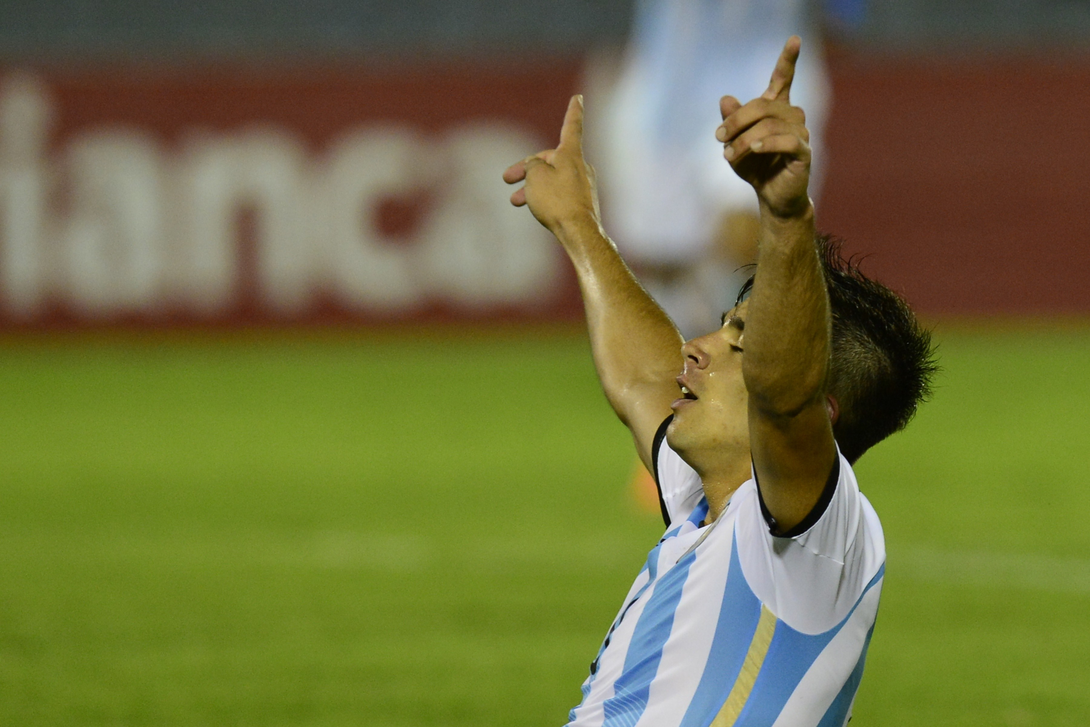 Argentina's forward Giovanni Simeone, celebrates his goal against Paraguay during their South American U-20 football match at the Centenario stadium in Montevideo on February 4, 2015. AFP PHOTO / PABLO PORCIUNCULA (Photo credit should read PABLO PORCIUNCULA/AFP/Getty Images)