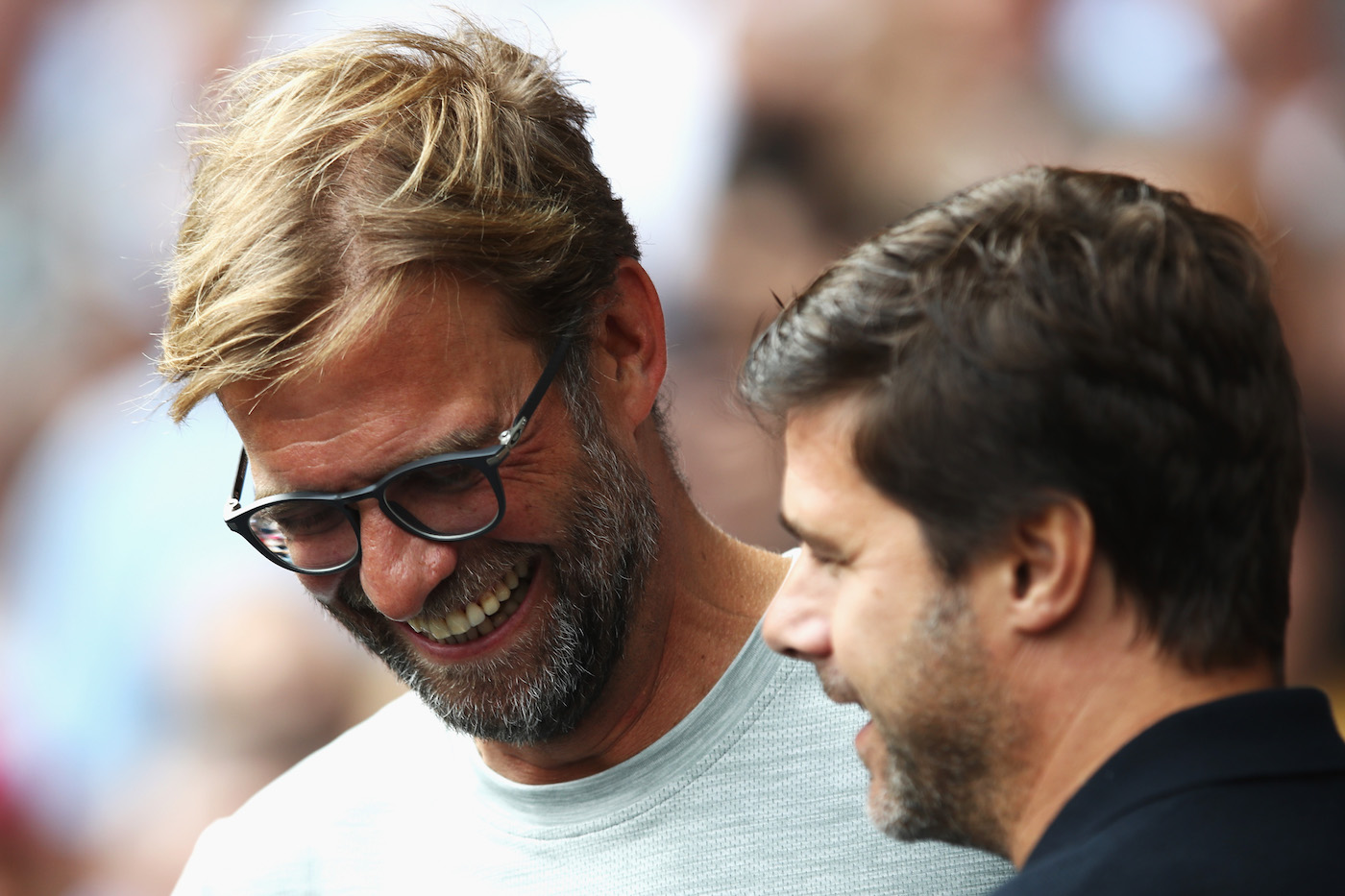 LONDON, ENGLAND - AUGUST 27: Jurgen Klopp, Manager of Liverpool (L) shares a smile with Mauricio Pochettino, Manager of Tottenham Hotspur (R) during the Premier League match between Tottenham Hotspur and Liverpool at White Hart Lane on August 27, 2016 in London, England. (Photo by Julian Finney/Getty Images)