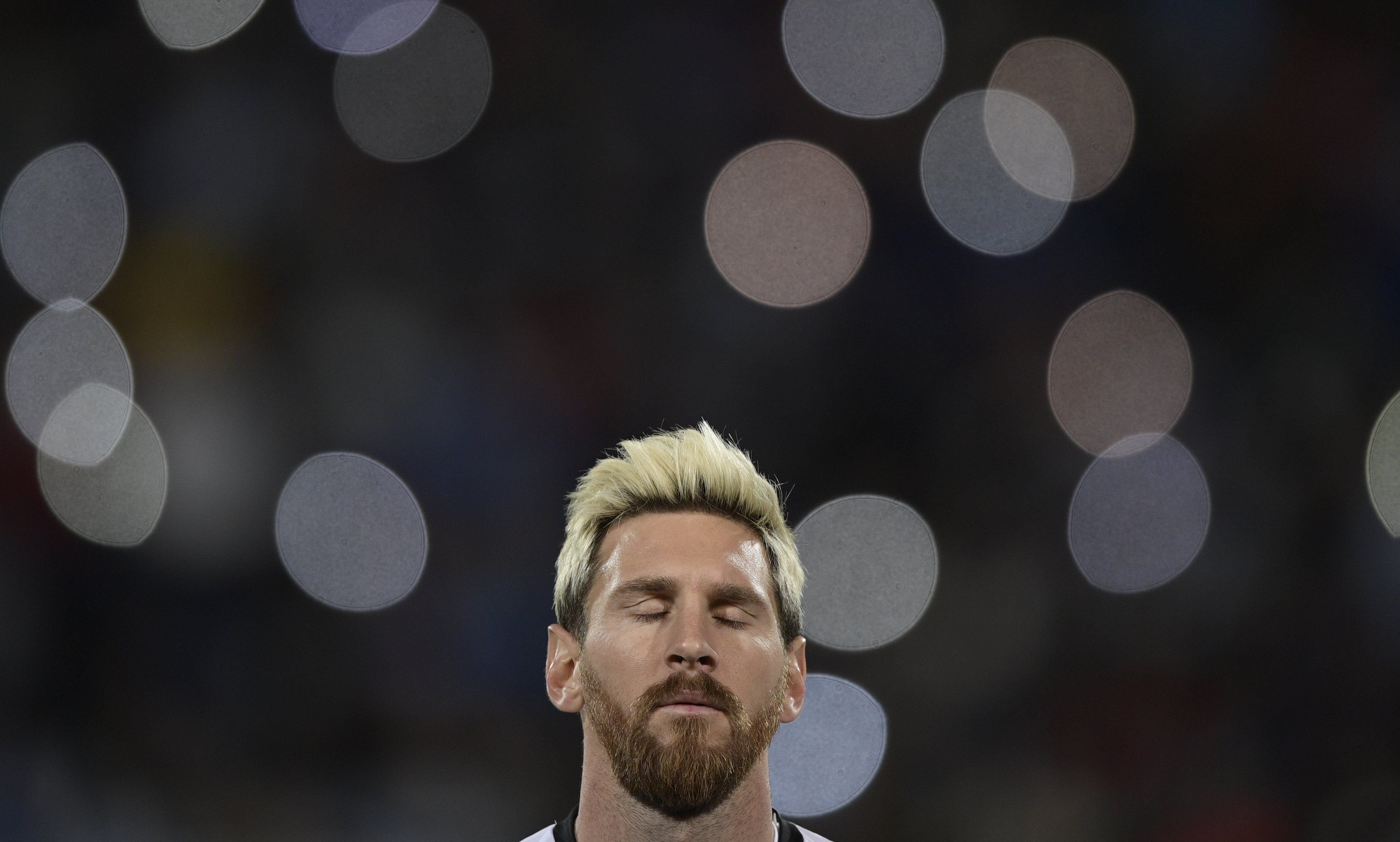 TOPSHOT - Argentina's Lionel Messi is seen before the start of the Russia 2018 World Cup qualifier football match in Mendoza, Argentina, on September 1, 2016. / AFP / JUAN MABROMATA (Photo credit should read JUAN MABROMATA/AFP/Getty Images)