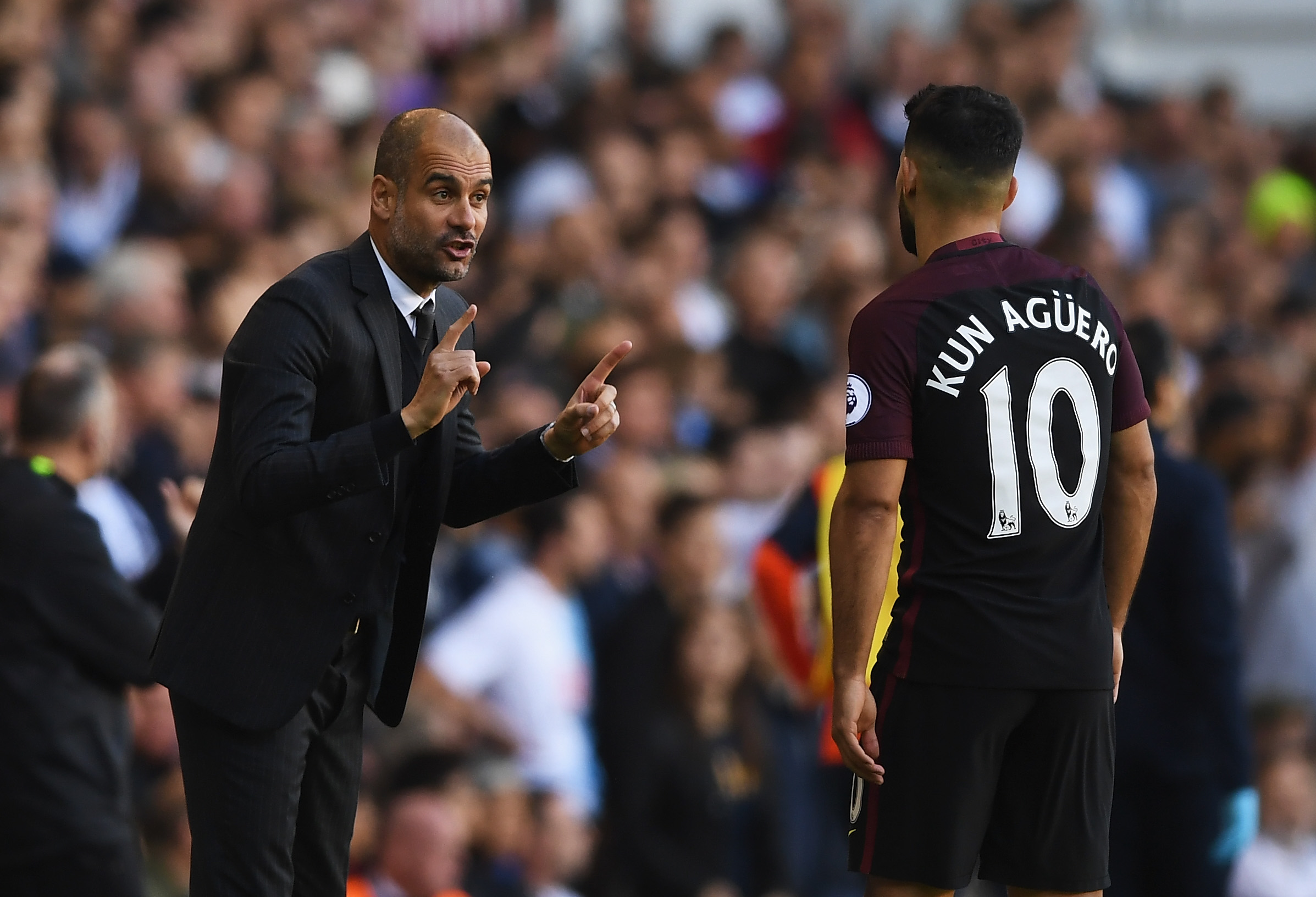 LONDON, ENGLAND - OCTOBER 02: Josep Guardiola, Manager of Manchester City (L) gives Sergio Aguero of Manchester City (R) instructions during the Premier League match between Tottenham Hotspur and Manchester City at White Hart Lane on October 2, 2016 in London, England. (Photo by Shaun Botterill/Getty Images)