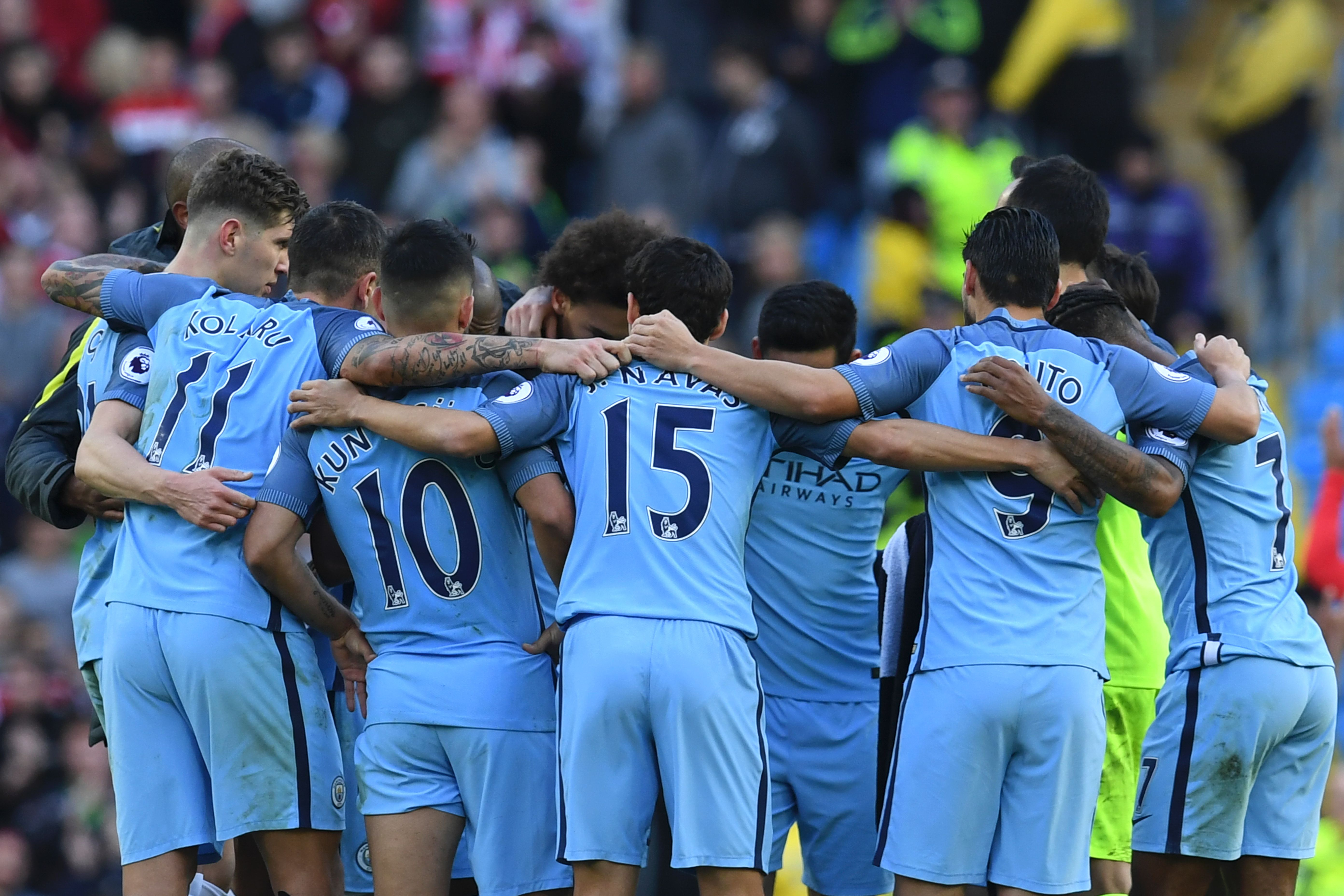 Manchester City players form a group huddle on the pitch after the English Premier League football match between Manchester City and Southampton at the Etihad Stadium in Manchester, north west England, on October 23, 2016. The game finished 1-1. / AFP / Paul ELLIS / RESTRICTED TO EDITORIAL USE. No use with unauthorized audio, video, data, fixture lists, club/league logos or 'live' services. Online in-match use limited to 75 images, no video emulation. No use in betting, games or single club/league/player publications. / (Photo credit should read PAUL ELLIS/AFP/Getty Images)