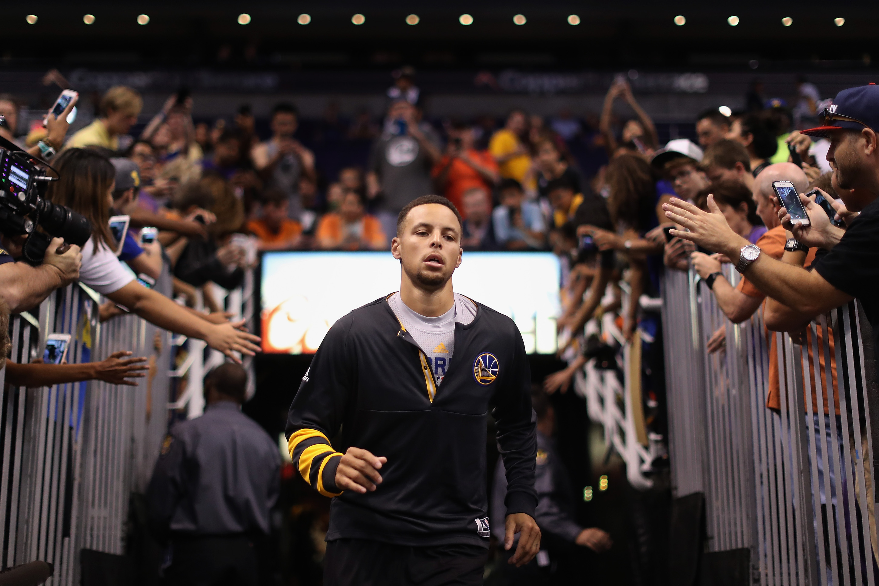 PHOENIX, AZ - OCTOBER 30: Stephen Curry #30 of the Golden State Warriors runs out onto the court before the NBA game against the Phoenix Suns at Talking Stick Resort Arena on October 30, 2016 in Phoenix, Arizona. NOTE TO USER: User expressly acknowledges and agrees that, by downloading and or using this photograph, User is consenting to the terms and conditions of the Getty Images License Agreement. (Photo by Christian Petersen/Getty Images)