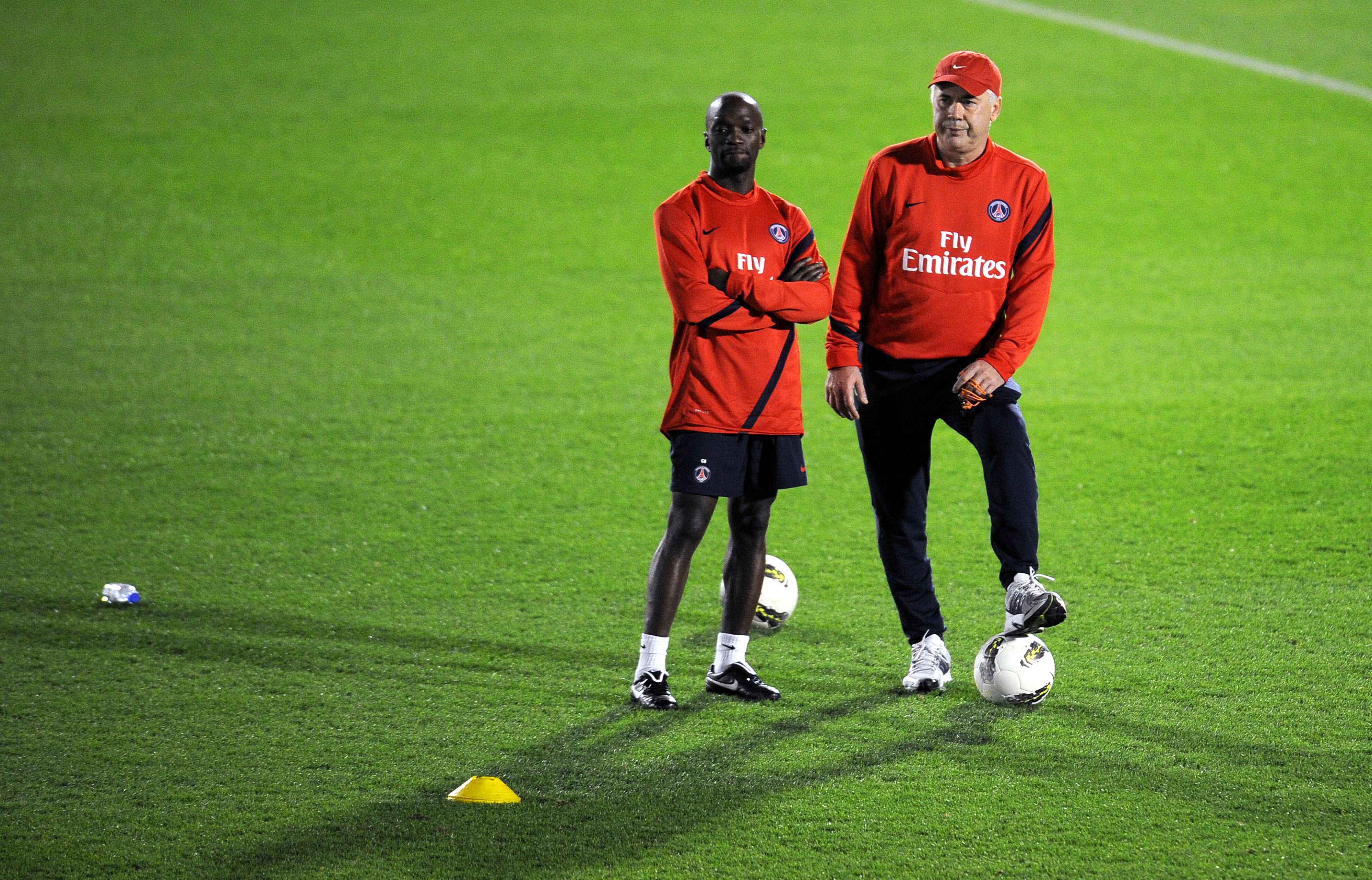 New coach of the Paris Saint-Germain football team Carlo Ancelotti (R) of Italy and new assistant coach Claude Makelele attend a training session at the Aspire complex in Doha on January 2, 2012. PSG will play a friendly football match against AC Milan on January 4 for the Dubai Football Challenege. AFP PHOTO/ FRANCK FIFE (Photo credit should read FRANCK FIFE/AFP/Getty Images)