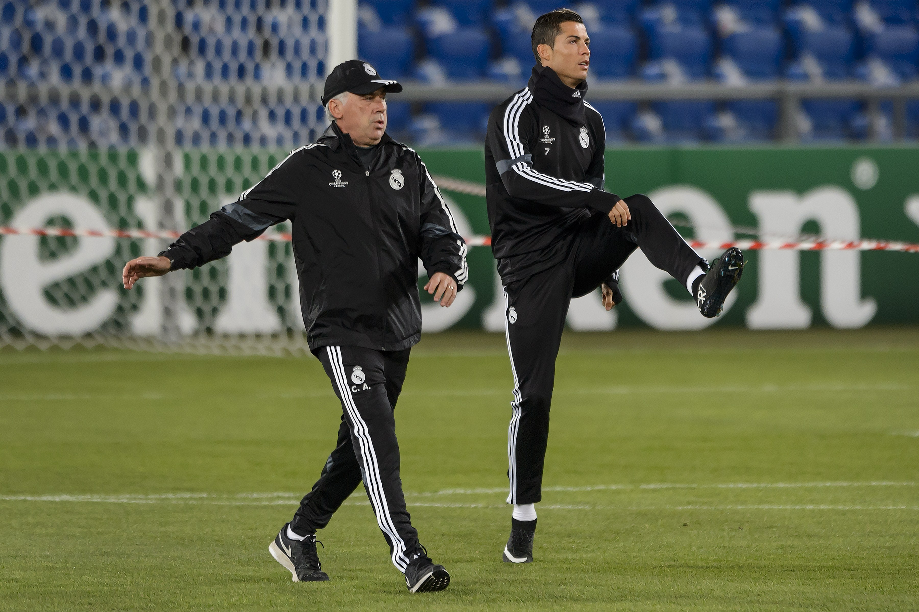 Real Madrid's Portuguese forward Cristiano Ronaldo (R) warms up next to Real Madrid's Italian coach Carlo Ancelotti during a training session on the eve of the UEFA Champions League Group B football match between FC Basel and Real Madrid on November 25, 2014 in Basel. AFP PHOTO / FABRICE COFFRINI (Photo credit should read FABRICE COFFRINI/AFP/Getty Images)