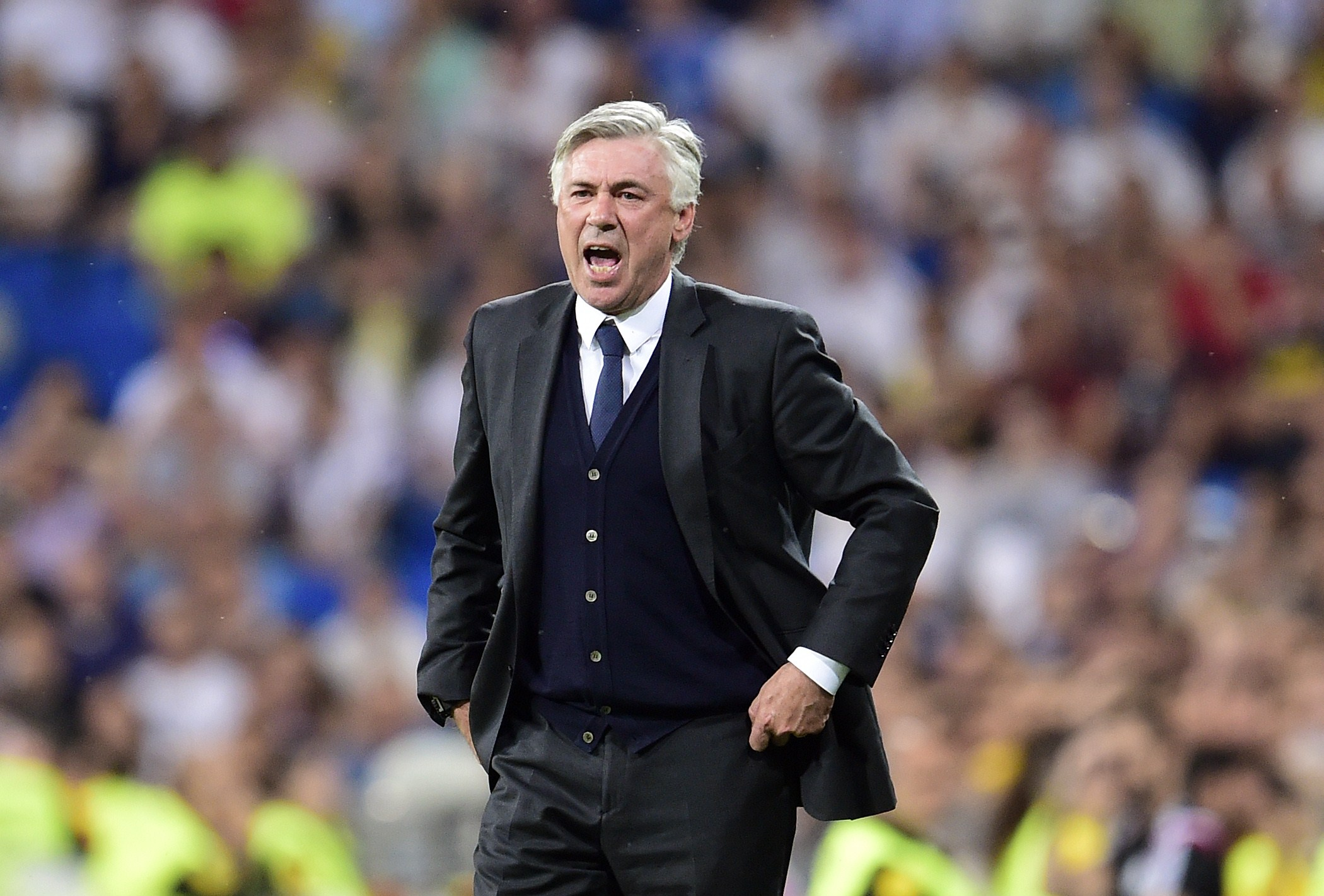 Real Madrid's Italian coach Carlo Ancelotti gestures during the Spanish league football match Real Madrid CF vs Valencia CF at the Santiago Bernabeu stadium in Madrid on May 9, 2015. The game ended with a draw 2-2. AFP PHOTO/ GERARD JULIEN (Photo credit should read GERARD JULIEN/AFP/Getty Images)