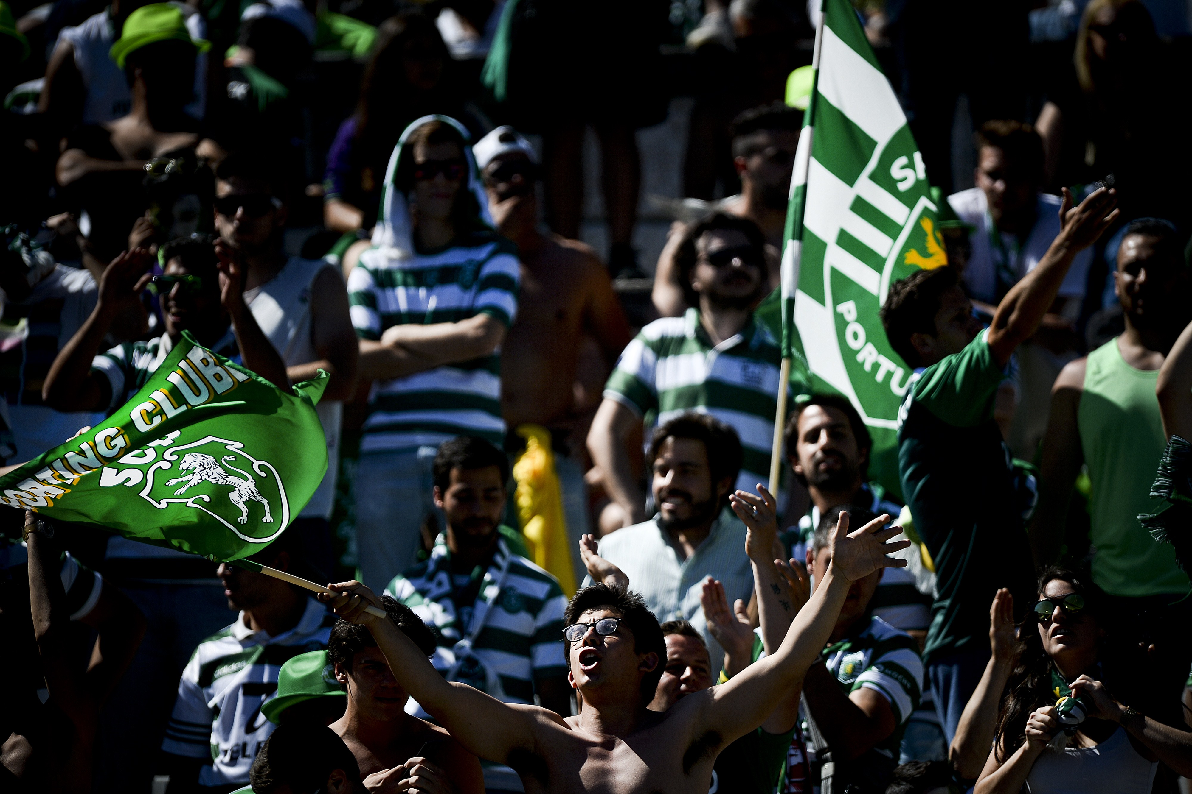 Sporting's supporters wave flags and shout slogans moments before the Taca de Portugal (Portuguese Cup) football match final Sporting CP vs SC Braga at Jamor stadium in Oeiras, outskirts of Lisbon on May 31, 2015. AFP PHOTO / PATRICIA DE MELO MOREIRA (Photo credit should read PATRICIA DE MELO MOREIRA/AFP/Getty Images)