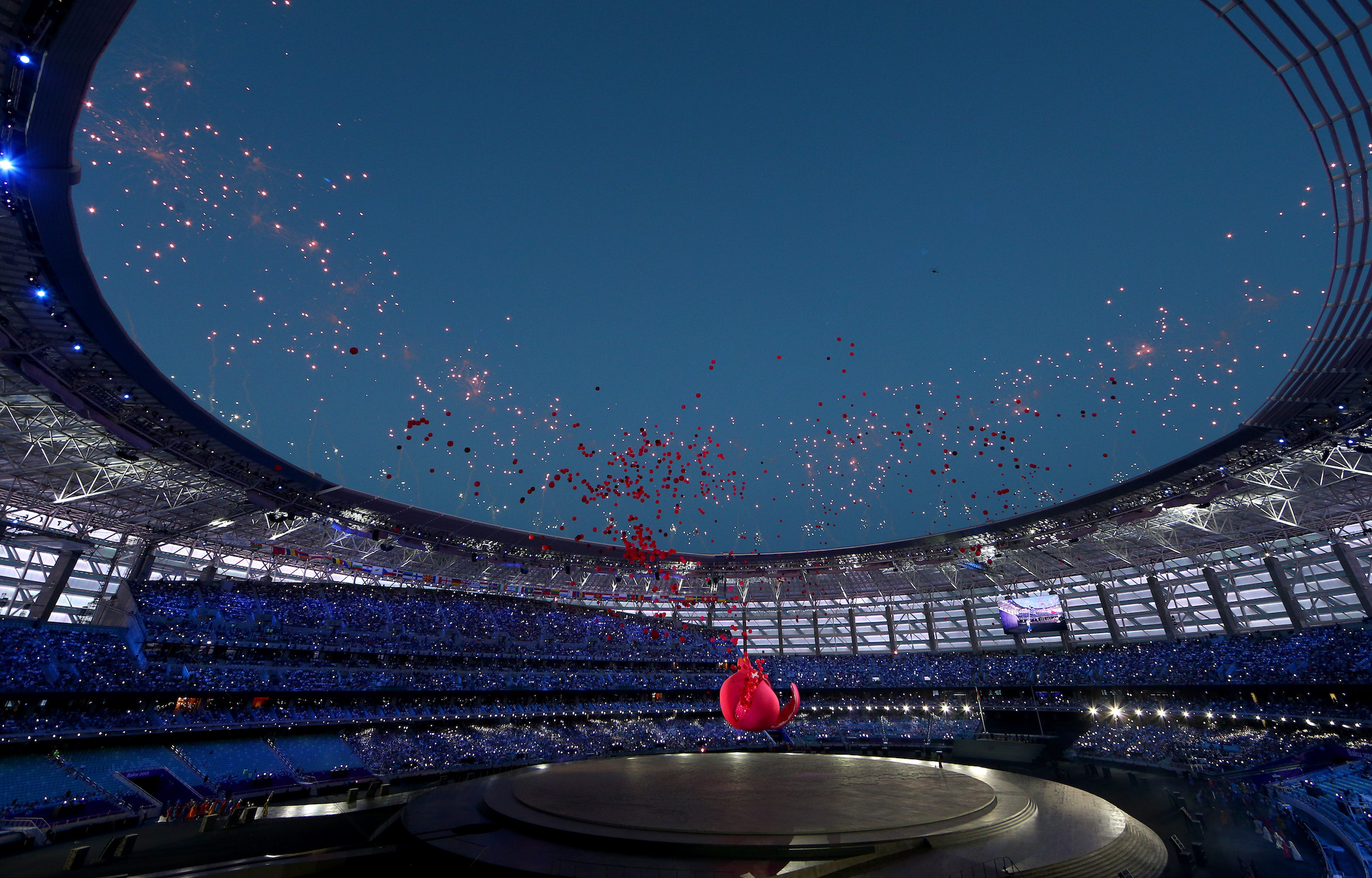 BAKU, AZERBAIJAN - JUNE 12: A general view of the stadium as a giant Pomegranate representing abundance, rebirth, love and good luck splits open to release its seeds during the Opening Ceremony for the Baku 2015 European Games at the Olympic Stadium on June 12, 2015 in Baku, Azerbaijan. (Photo by Harry Engels/Getty Images for BEGOC)