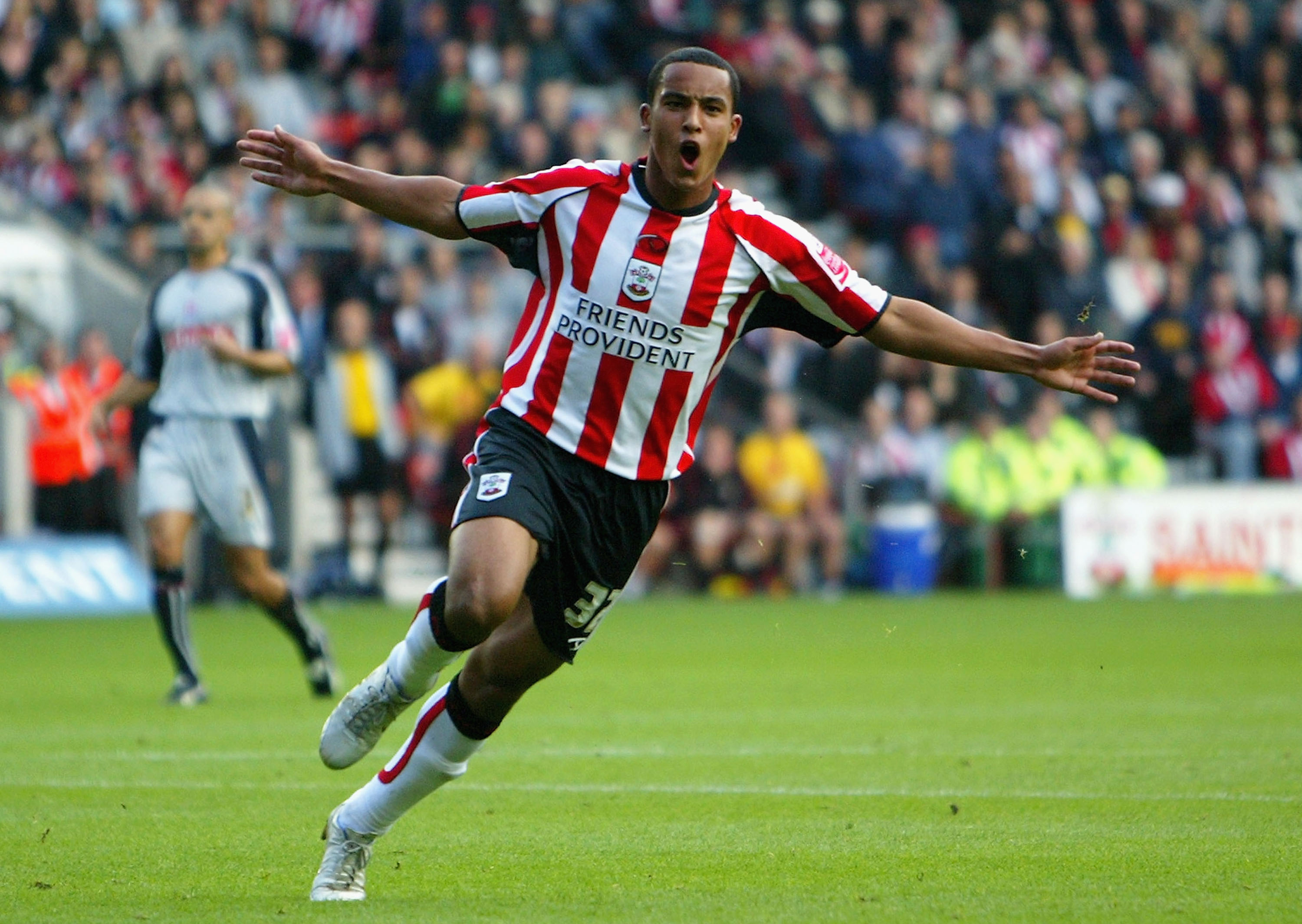SOUTHAMPTON, UNITED KINGDOM - OCTOBER 29: Theo Walcott of Southampton celebrates scoring a goal during the Coca-Cola Championship match between Southampton and Stoke City at St Mary's Stadium on October 29, 2005 in Southampton, England. (Photo by Julian Finney/Getty Images)