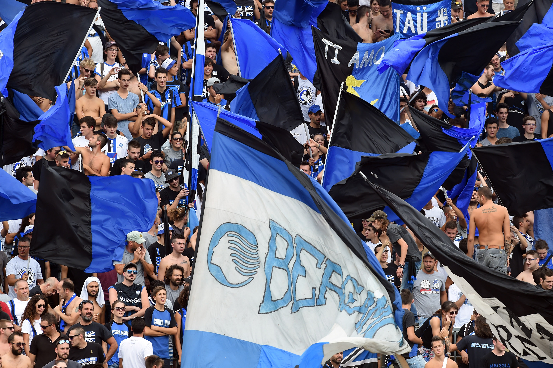 BERGAMO, ITALY - SEPTEMBER 11: Atalanta fans waving flags during the Serie a match between Atalanta BC and FC Torino at Stadio Atleti Azzurri d'Italia on September 11, 2016 in Bergamo, Italy. (Photo by Pier Marco Tacca/Getty Images)