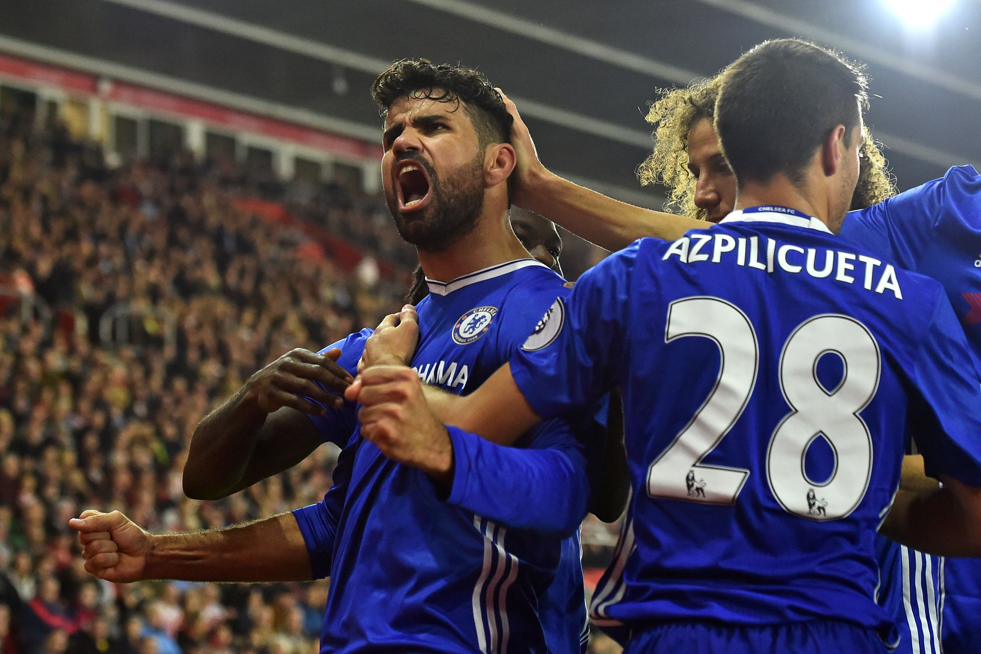 Chelsea's Brazilian-born Spanish striker Diego Costa (L) celebrates scoring their second goal during the English Premier League football match between Southampton and Chelsea at St Mary's Stadium in Southampton, southern England on October 30, 2016. / AFP / GLYN KIRK / RESTRICTED TO EDITORIAL USE. No use with unauthorized audio, video, data, fixture lists, club/league logos or 'live' services. Online in-match use limited to 75 images, no video emulation. No use in betting, games or single club/league/player publications. / (Photo credit should read GLYN KIRK/AFP/Getty Images)