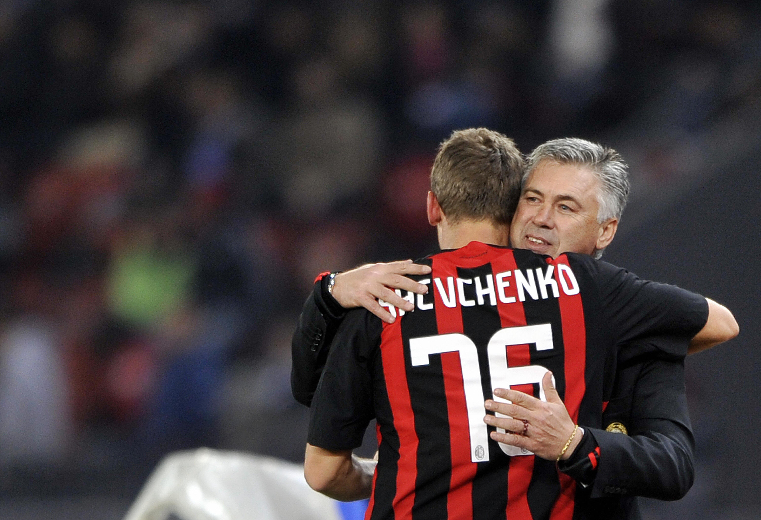 AC Milan's Andrei Shevchenko is congratulates by team coach Carlo Ancelotti after he scored the first goal during their UEFA Cup first round, second leg football game against FC Zurich on October 2, 2008 in Zurich. AFP PHOTO / FABRICE COFFRINI (Photo credit should read FABRICE COFFRINI/AFP/Getty Images)