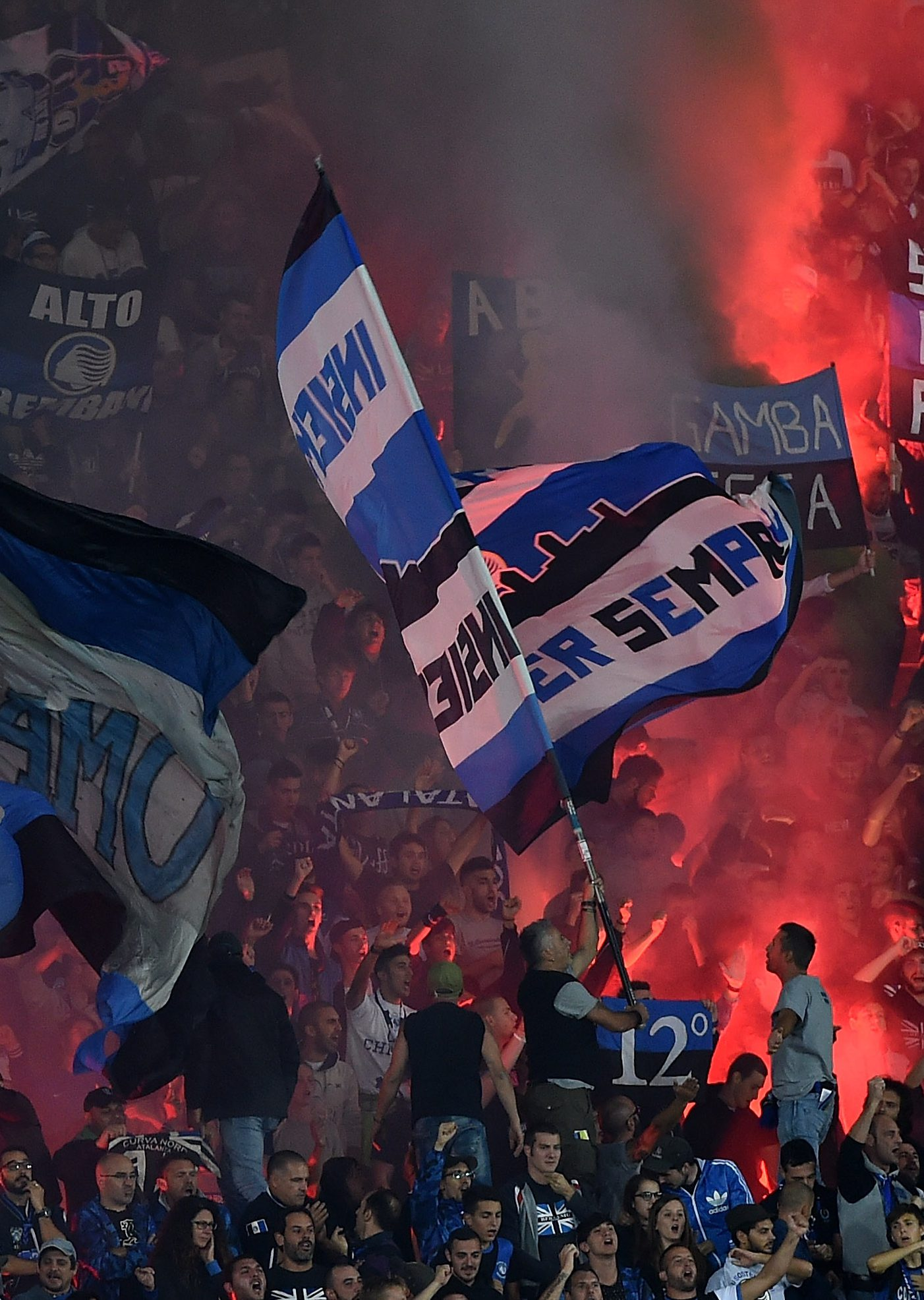 BERGAMO, ITALY - SEPTEMBER 21: Fans of Atalanta show their support during the Serie A match between Atalanta BC and US Citta di Palermo at Stadio Atleti Azzurri d'Italia on September 21, 2016 in Bergamo, Italy. (Photo by Tullio M. Puglia/Getty Images)