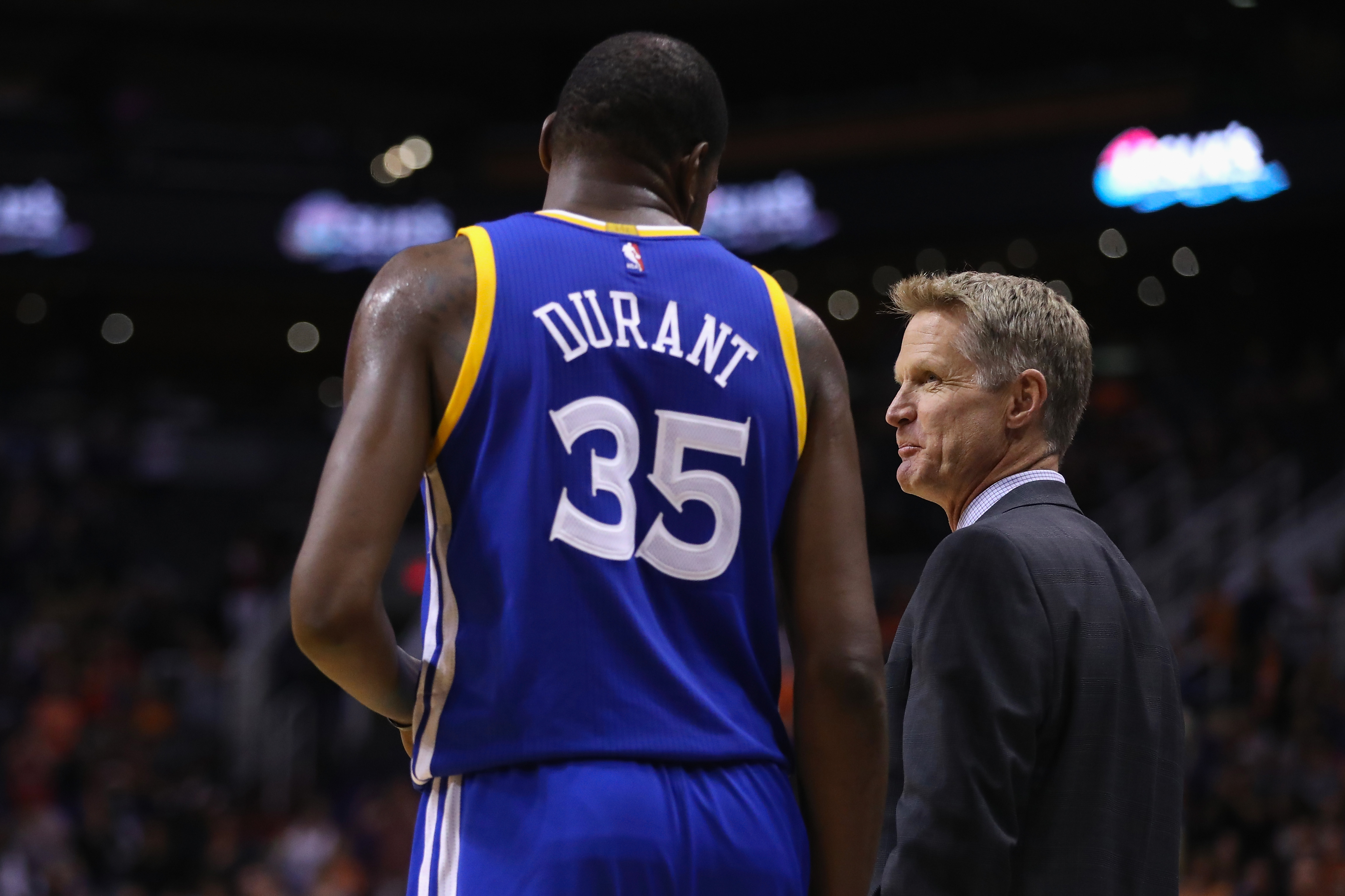 PHOENIX, AZ - OCTOBER 30: Head coach Steve Kerr of the Golden State Warriors talks with Kevin Durant #35 during the second half of the NBA game against the Phoenix Suns at Talking Stick Resort Arena on October 30, 2016 in Phoenix, Arizona. The Warriors defeated the Suns 106 -100. NOTE TO USER: User expressly acknowledges and agrees that, by downloading and or using this photograph, User is consenting to the terms and conditions of the Getty Images License Agreement. (Photo by Christian Petersen/Getty Images)