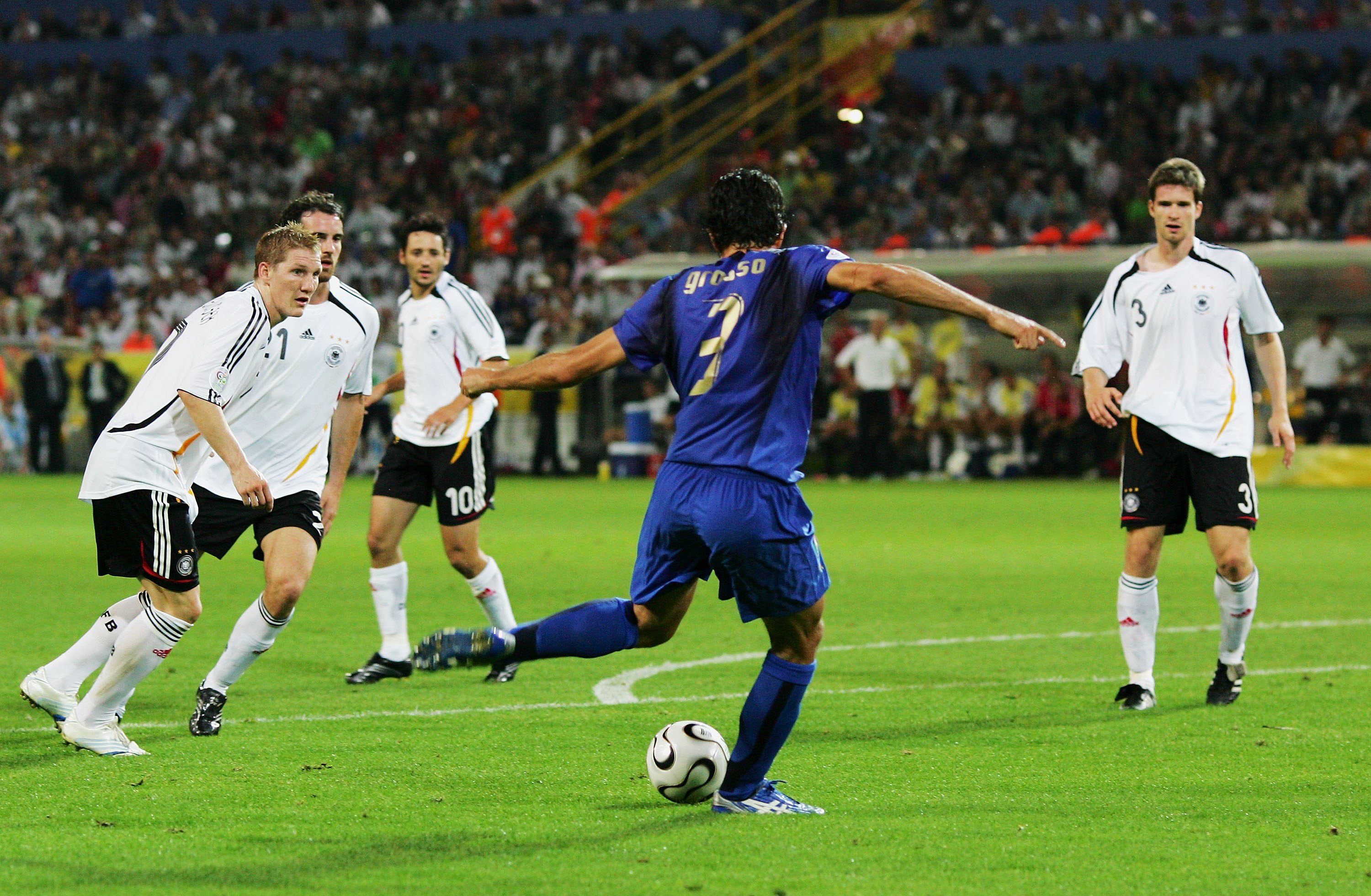 DORTMUND, GERMANY - JULY 04: Fabio Grosso of Italy scores his team's first goal in extra time during the FIFA World Cup Germany 2006 Semi-final match between Germany and Italy played at the Stadium Dortmund on July 04, 2006 in Dortmund, Germany. (Photo by Alex Livesey/Getty Images)