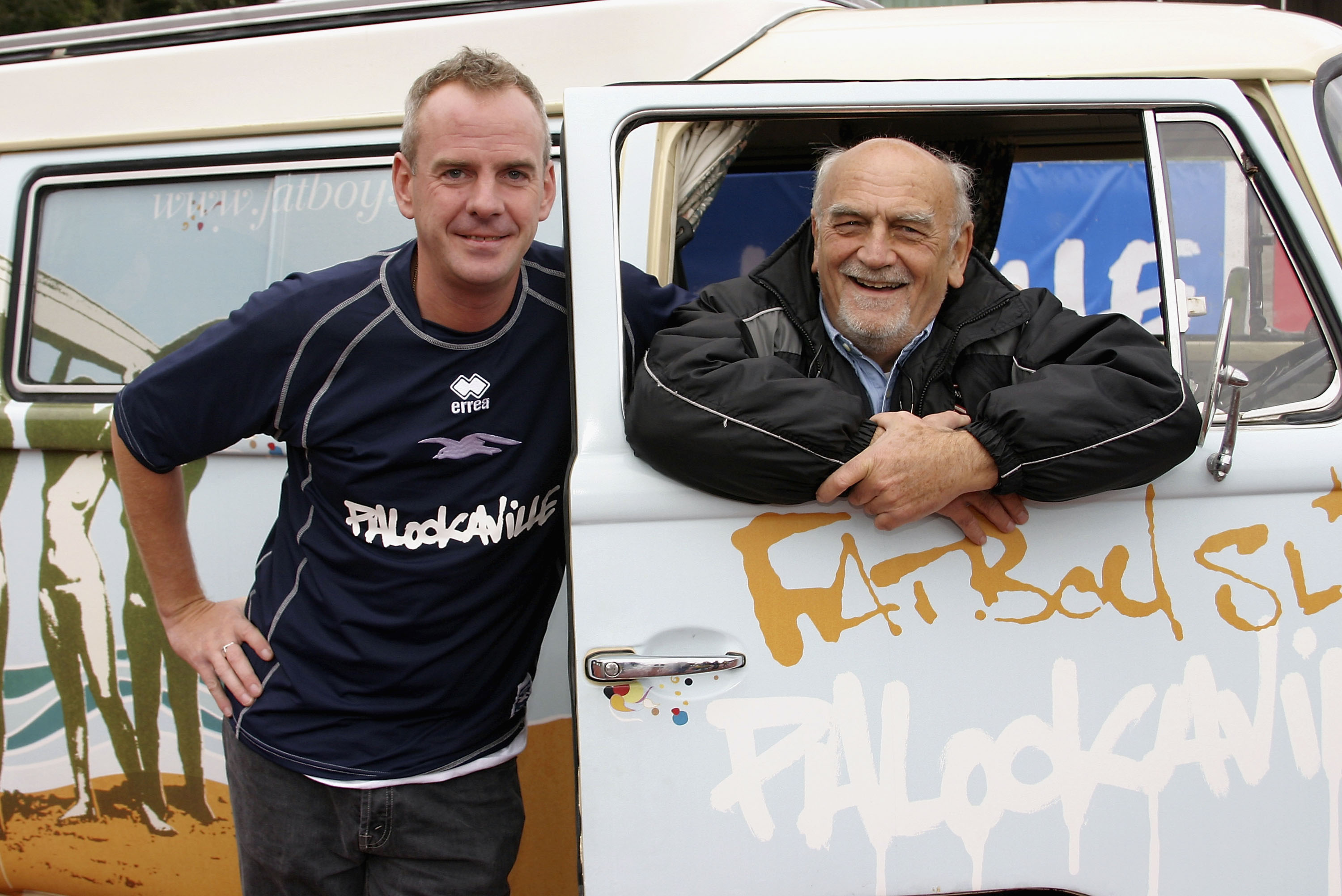 BRIGHTON, ENGLAND - OCTOBER 2: DJ and Brighton and Hove Albion fan Fatboy Slim poses with Brighton Chairman Dick Knight as he launches his new album 'Palookaville' at Withdean Stadium in Brighton on October 2, 2004 in Brighton, England. Fatboy Slim has changed the name of the Withdean Stadium to 'Palookaville' for the match against Sheffield United. (Photo by Dave Etheridge-Barnes/Getty Images)