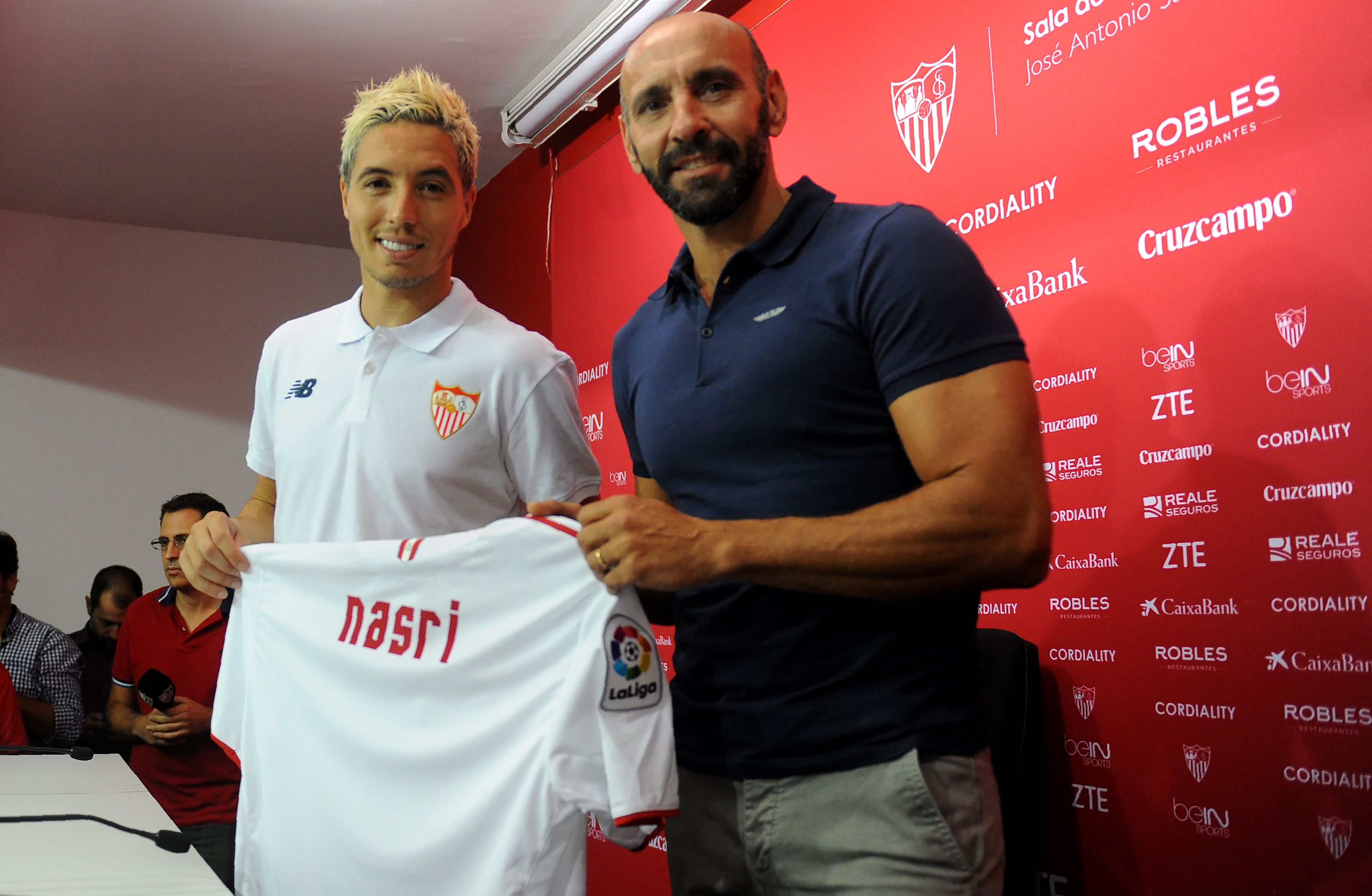 Sevilla's new French player Samir Nasri (L) poses with Sevilla's sports director Monchi, during his official presentation at the Ramon Sanchez Pizjuan stadium in Sevilla on September 1, 2016. / AFP / Cristina Quicler (Photo credit should read CRISTINA QUICLER/AFP/Getty Images)