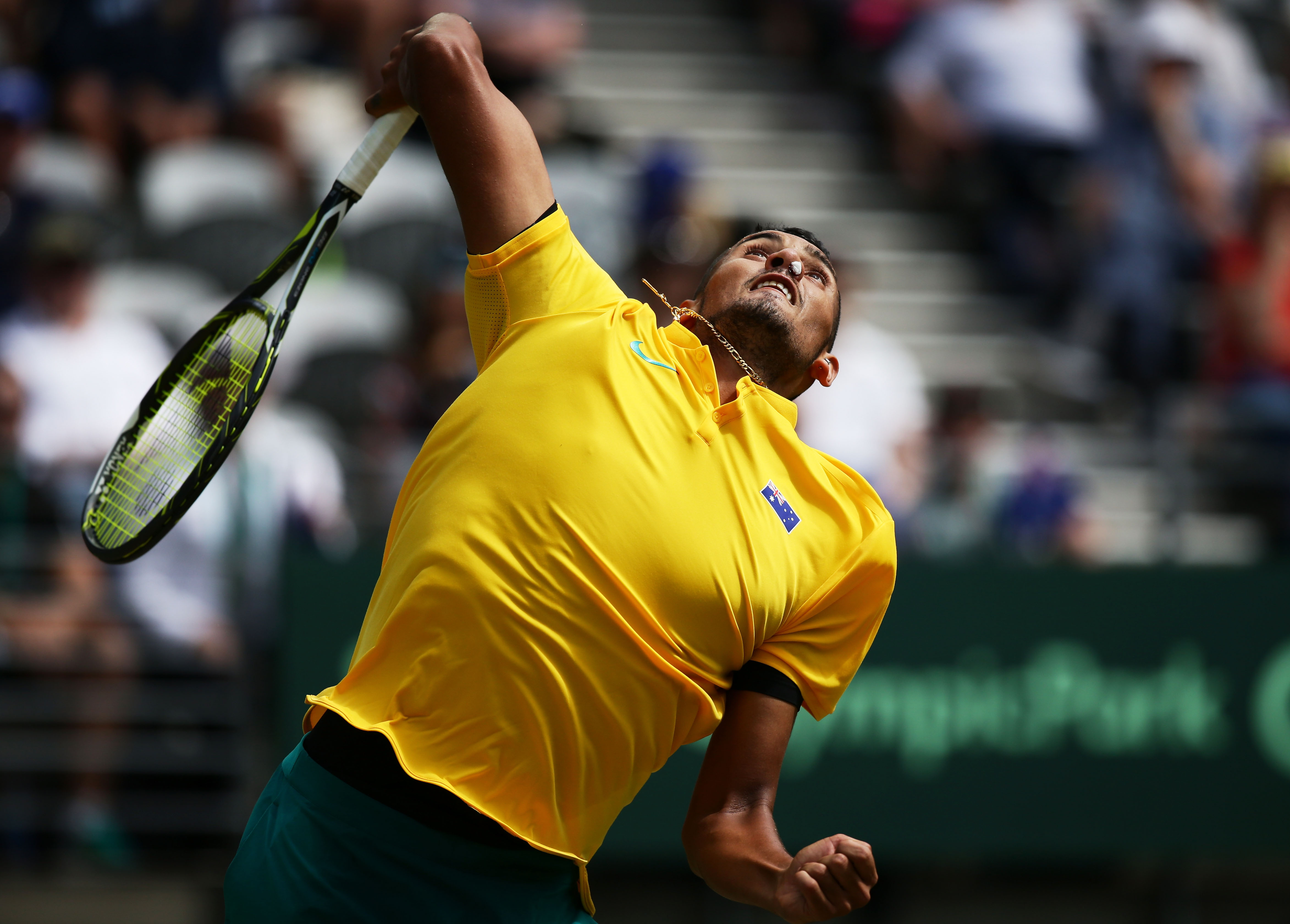 SYDNEY, AUSTRALIA - SEPTEMBER 16: Nick Kyrgios of Australia serves with his nose plugged due to a nose bleed in his singles match against Andrej Martin of Slovakia during the Davis Cup World Group playoff between Australia and Slovakia at Sydney Olympic Park Tennis Centre on September 16, 2016 in Sydney, Australia. (Photo by Matt King/Getty Images)