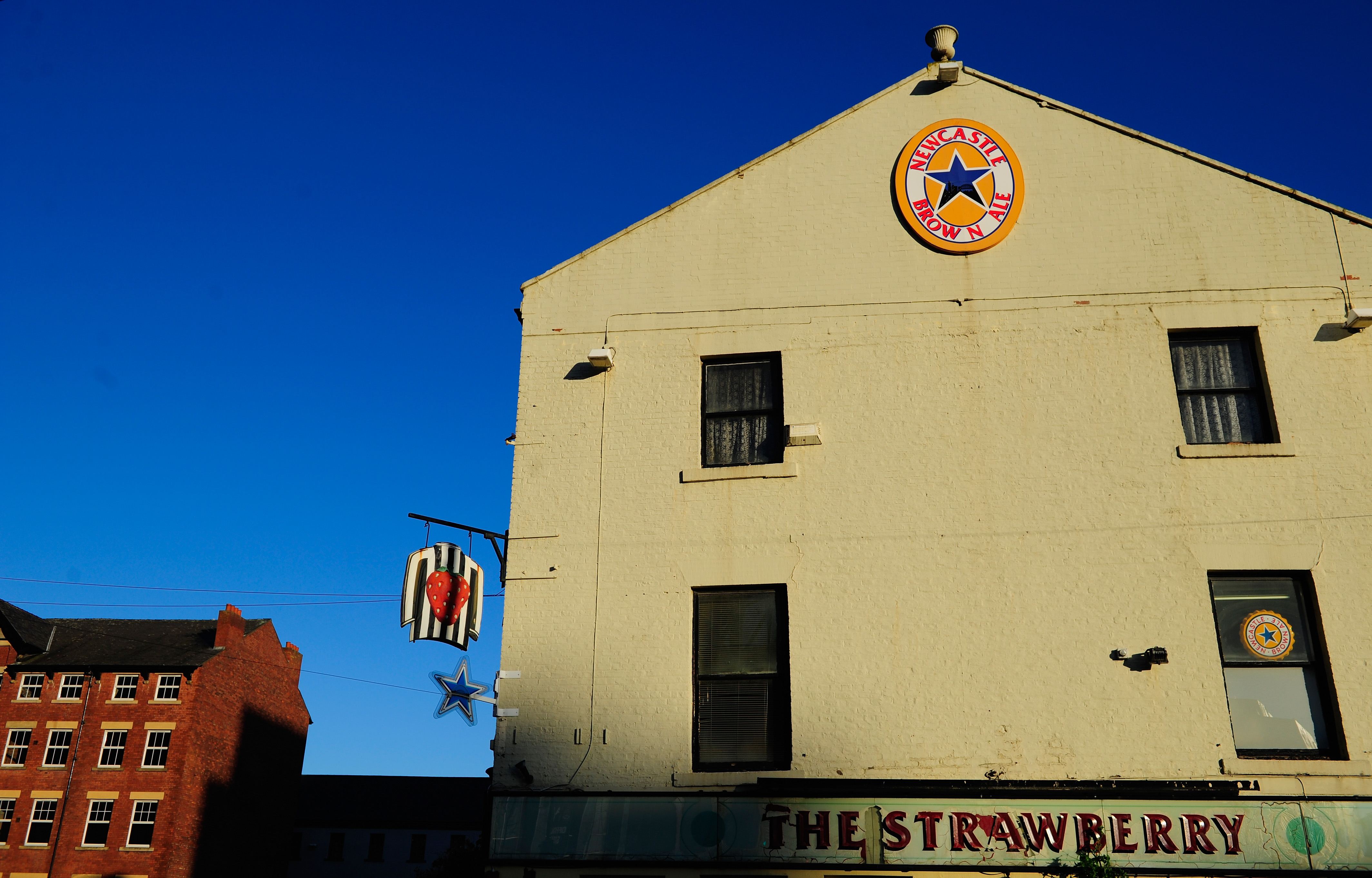 NEWCASTLE UPON TYNE, ENGLAND - DECEMBER 26: A close up of the famous 'Strawberry' Pub before the Barclays Premier League match between Newcastle United and Stoke City at St James' Park on December 26, 2013 in Newcastle upon Tyne, England. (Photo by Stu Forster/Getty Images)