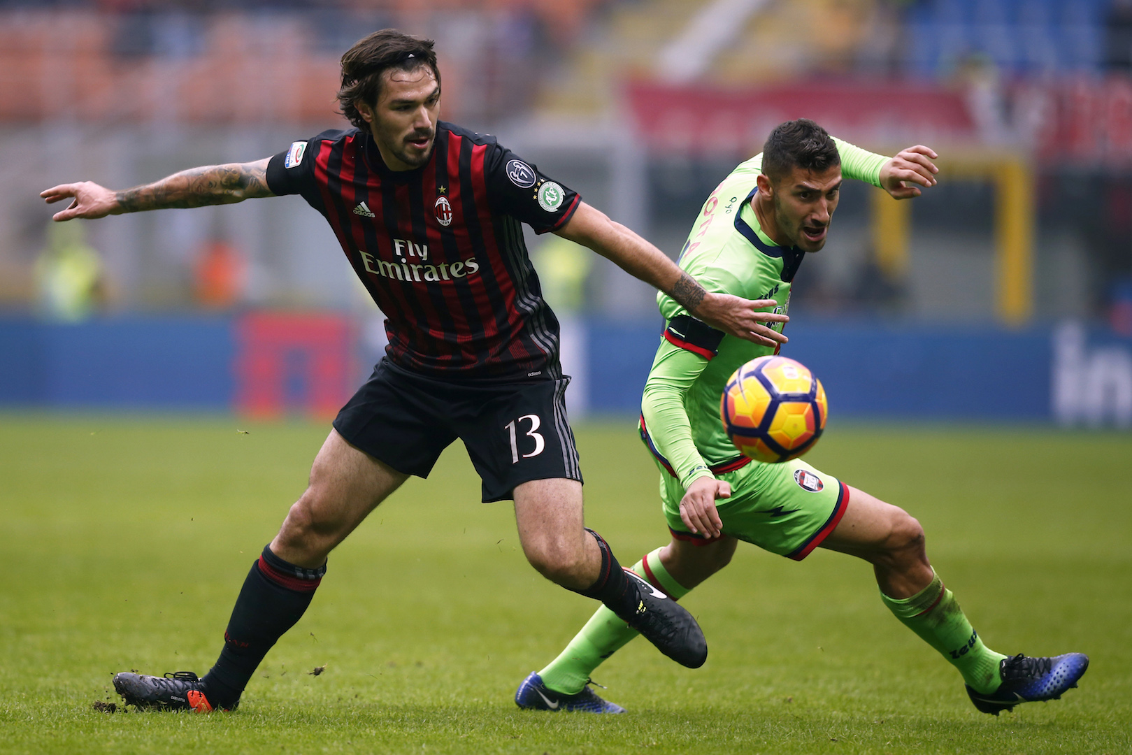 AC Milan's defender Alessio Romagnoli (L) fights for the ball with Crotone's forward Diego Falcinelli during the Italian Serie A football match AC Milan Vs Crotone on December 4, 2016 at the 'San Siro Stadium' in Milan. / AFP / MARCO BERTORELLO (Photo credit should read MARCO BERTORELLO/AFP/Getty Images)