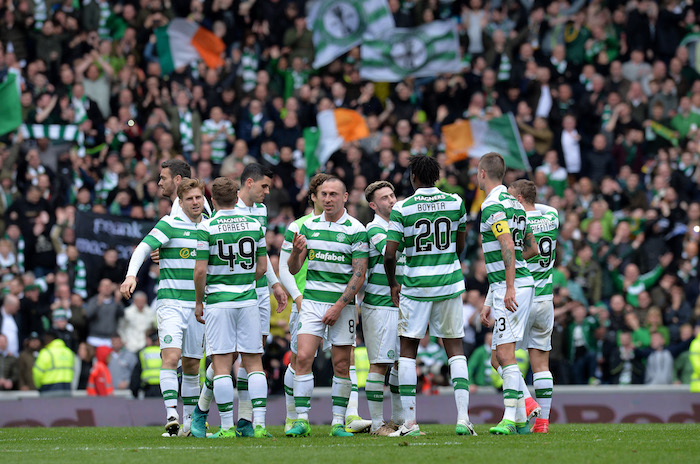 GLASGOW, SCOTLAND - APRIL 29: Celtic players celebrate at the final whistle after beating rangers 5-1 during the Ladbrokes Scottish Premiership match between Rangers FC and Celtic FC at Ibrox Stadium on April 29, 2017 in Glasgow, Scotland. (Photo by Mark Runnacles/Getty Images)