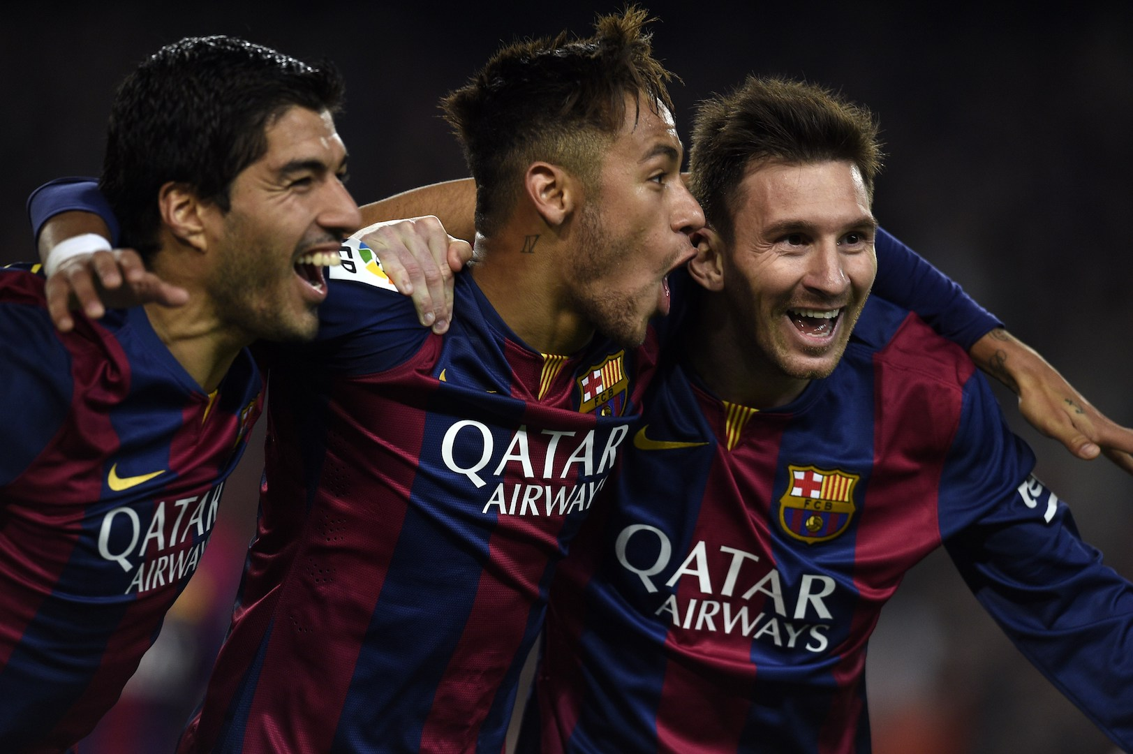 Barcelona's Argentinian forward Lionel Messi, Barcelona's Brazilian forward Neymar da Silva Santos Junior and Barcelona's Uruguayan forward Luis Suarez celebrate during the Spanish league football match FC Barcelona vs Club Atletico de Madrid at the Camp Nou stadium in Barcelona on January 11, 2015. AFP PHOTO/ LLUIS GENE (Photo credit should read LLUIS GENE/AFP/Getty Images)