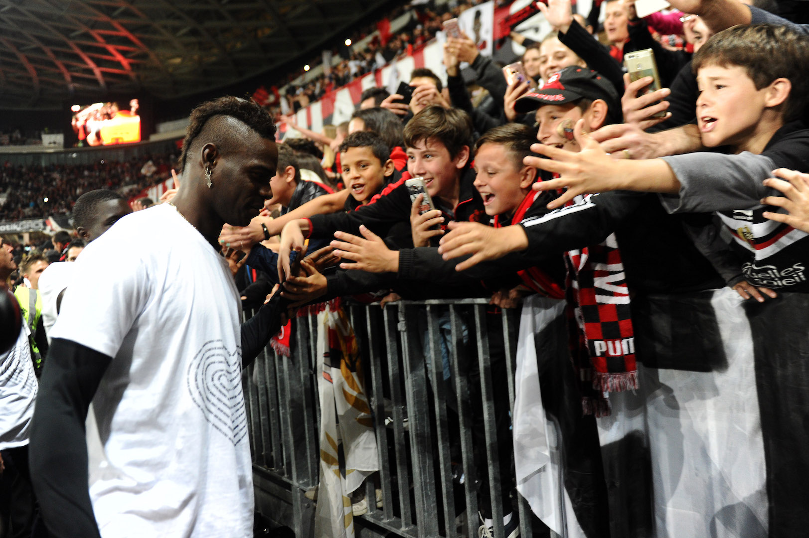 Nice's Italian forward Mario Balotelli celebrates with supporters at the end of the French L1 football match Nice vs Angers on May 14, 2017, at the Allianz Riviera stadium in Nice, southeastern France. / AFP PHOTO / Franck PENNANT (Photo credit should read FRANCK PENNANT/AFP/Getty Images)