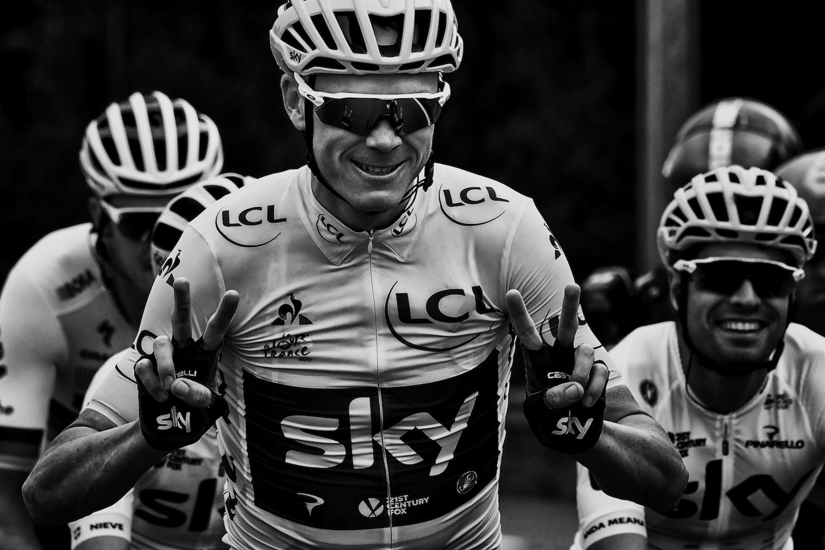 BLACK AND WHITE VERSION Great Britain's Christopher Froome (C) wearing the overall leader's yellow jersey flashes victory signs next to Spain's Mikel Landa during the 103 km twenty-first and last stage of the 104th edition of the Tour de France cycling race on July 23, 2017 between Montgeron and Paris Champs-Elysees. / AFP PHOTO / JEFF PACHOUD (Photo credit should read JEFF PACHOUD/AFP/Getty Images)