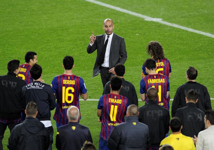 Barcelona's coach Josep Guardiola salute