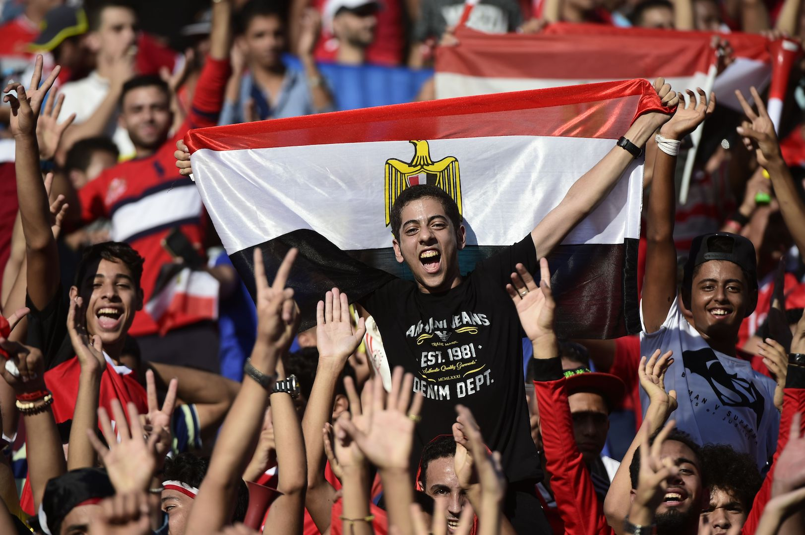 Egyptian fans cheer for their national team before the FIFA World Cup 2018 qualification football match between Egypt and Uganda at the Borg al-Arab Stadium near Alexandria on September 5, 2017. / AFP PHOTO / KHALED DESOUKI (Photo credit should read KHALED DESOUKI/AFP/Getty Images)